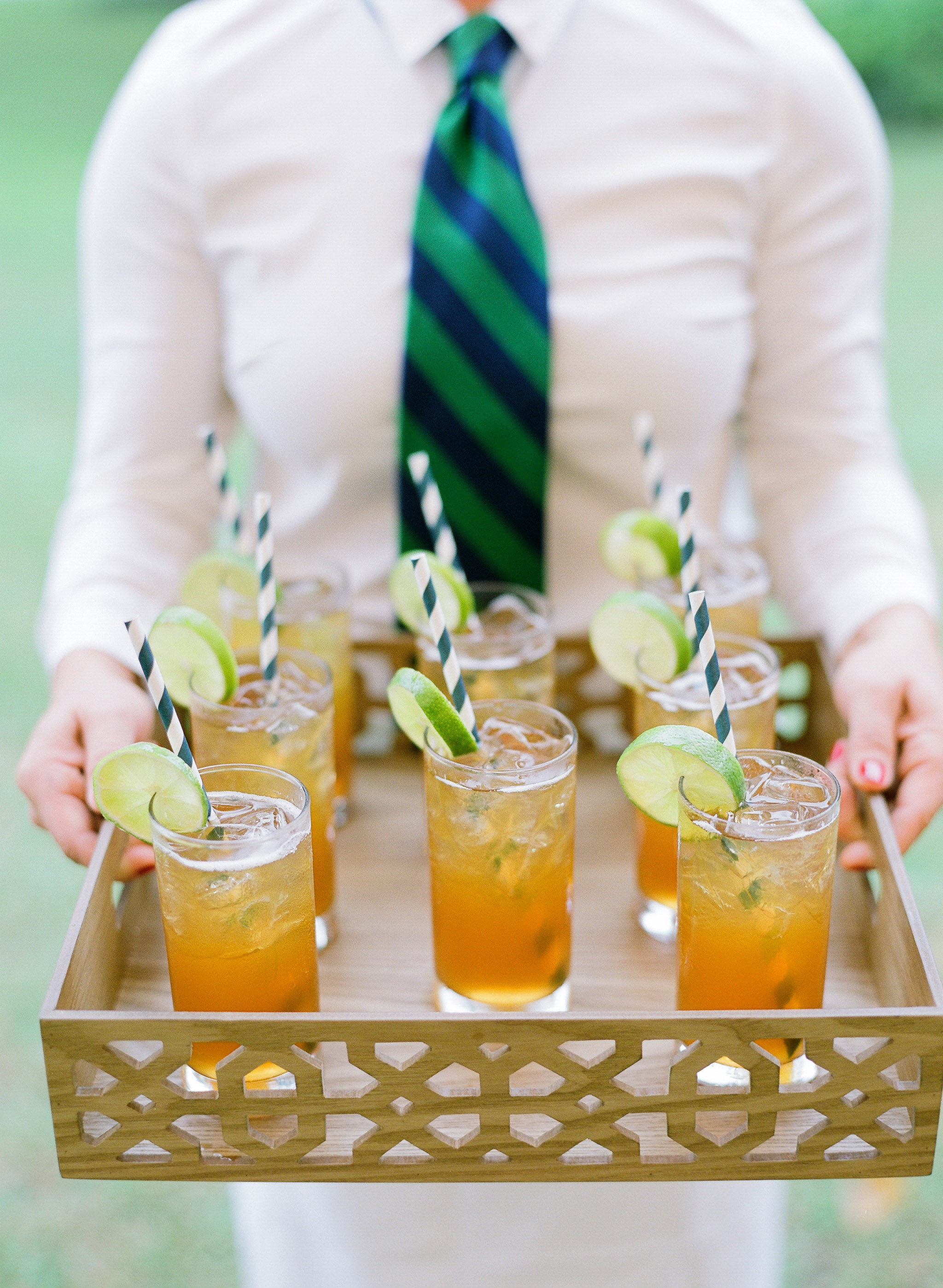 striped beverage straws with striped tie on server