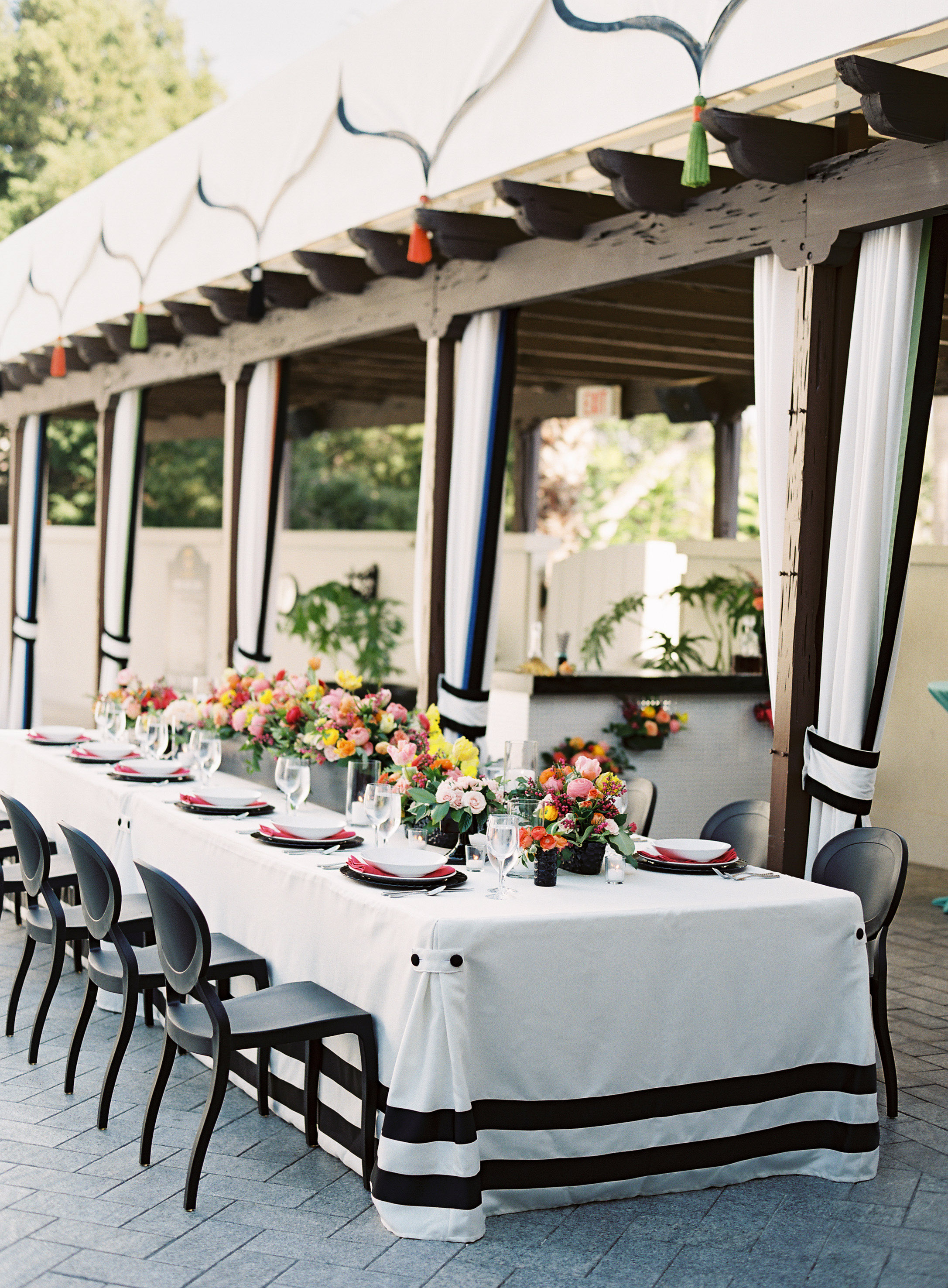 striped long table covers with black chairs