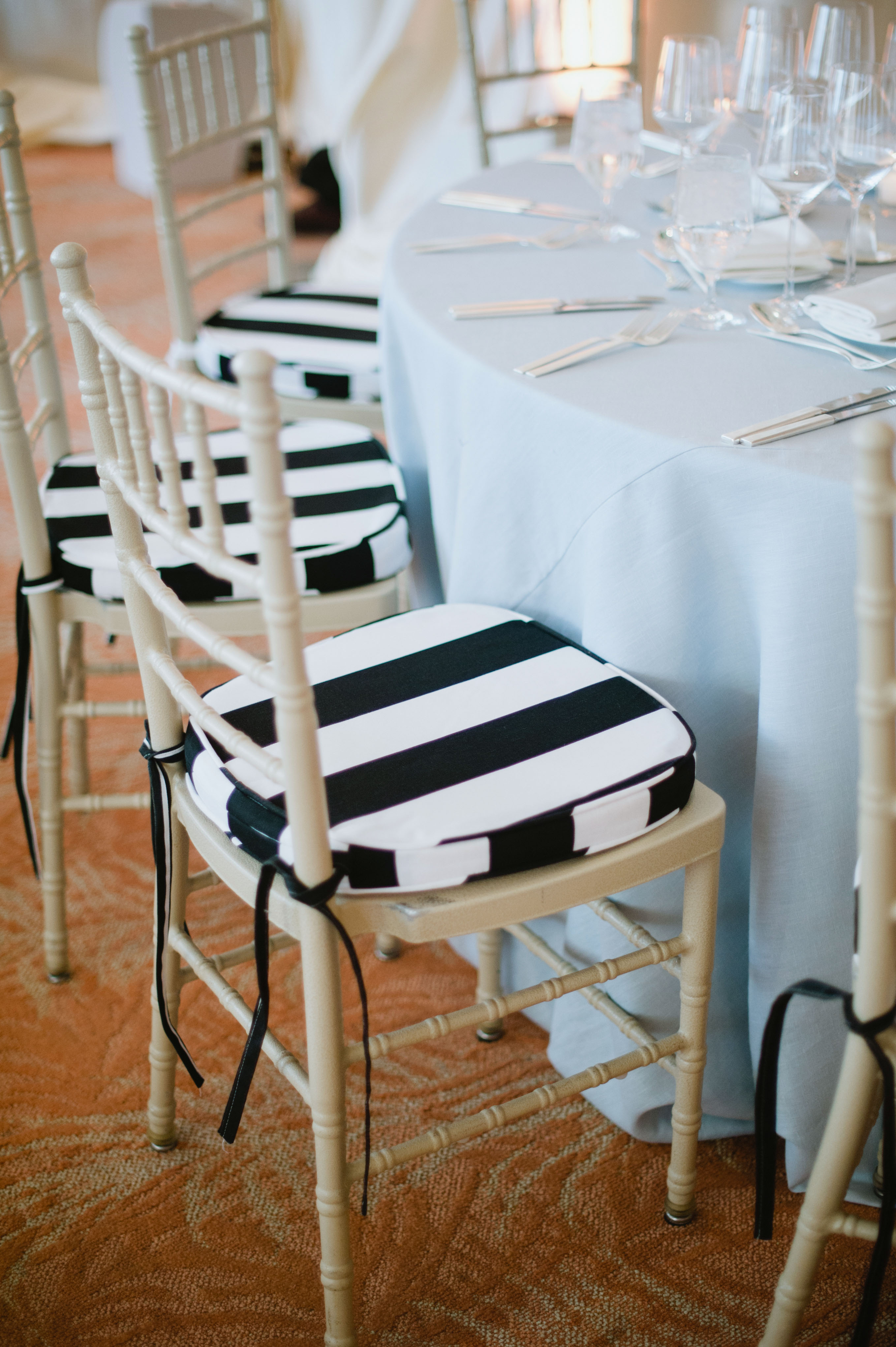 striped seat cushions of dining area wedding reception