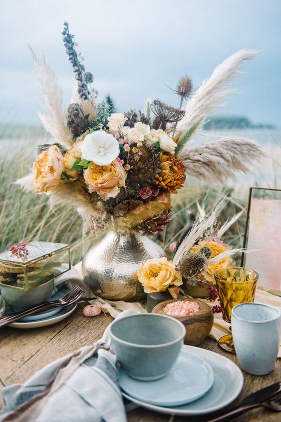 beach wedding ideas table setting on beach with sea urchin decor