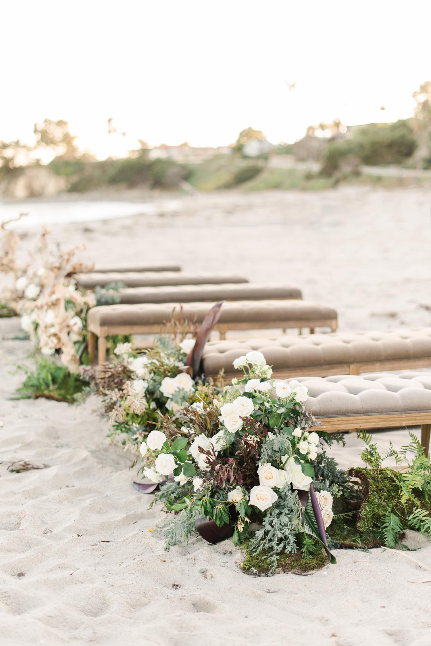 beach wedding ideas benches arranged on beach