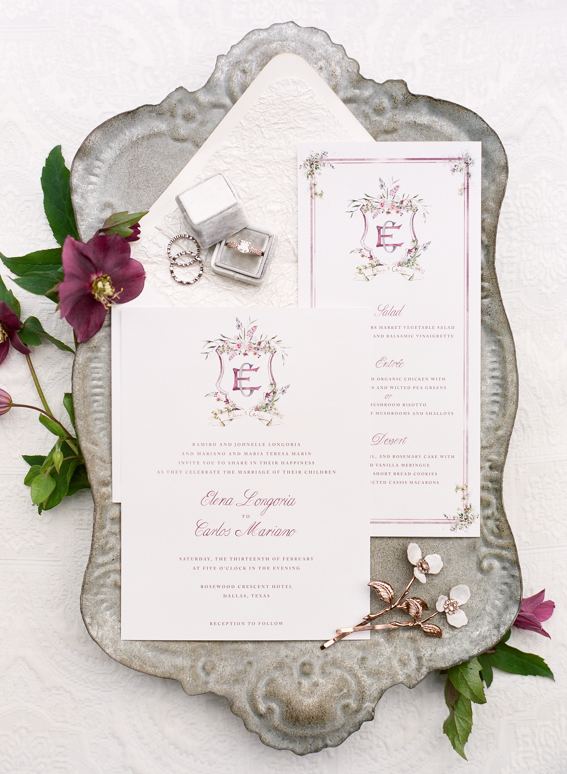 Elegant white wedding invitation suite with floral monogram