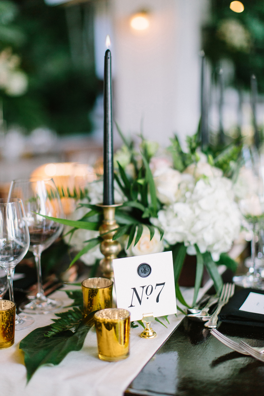 black white gold table setting