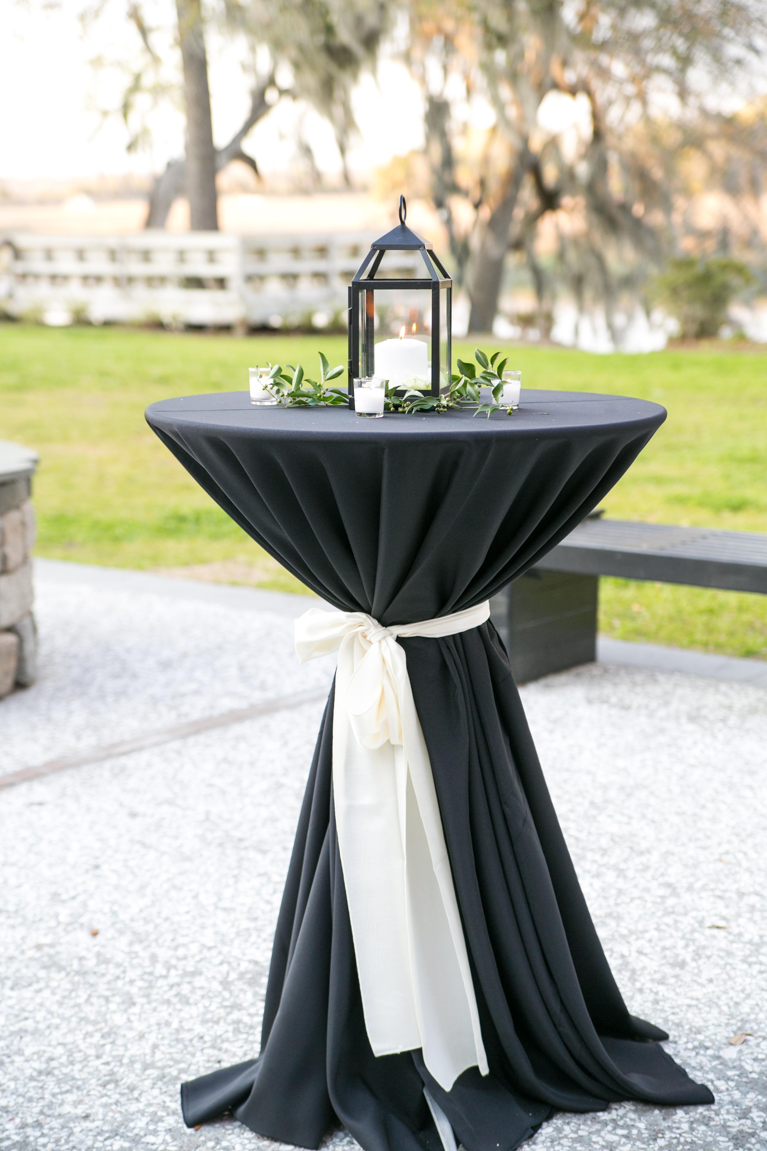 black white cocktail table with lantern