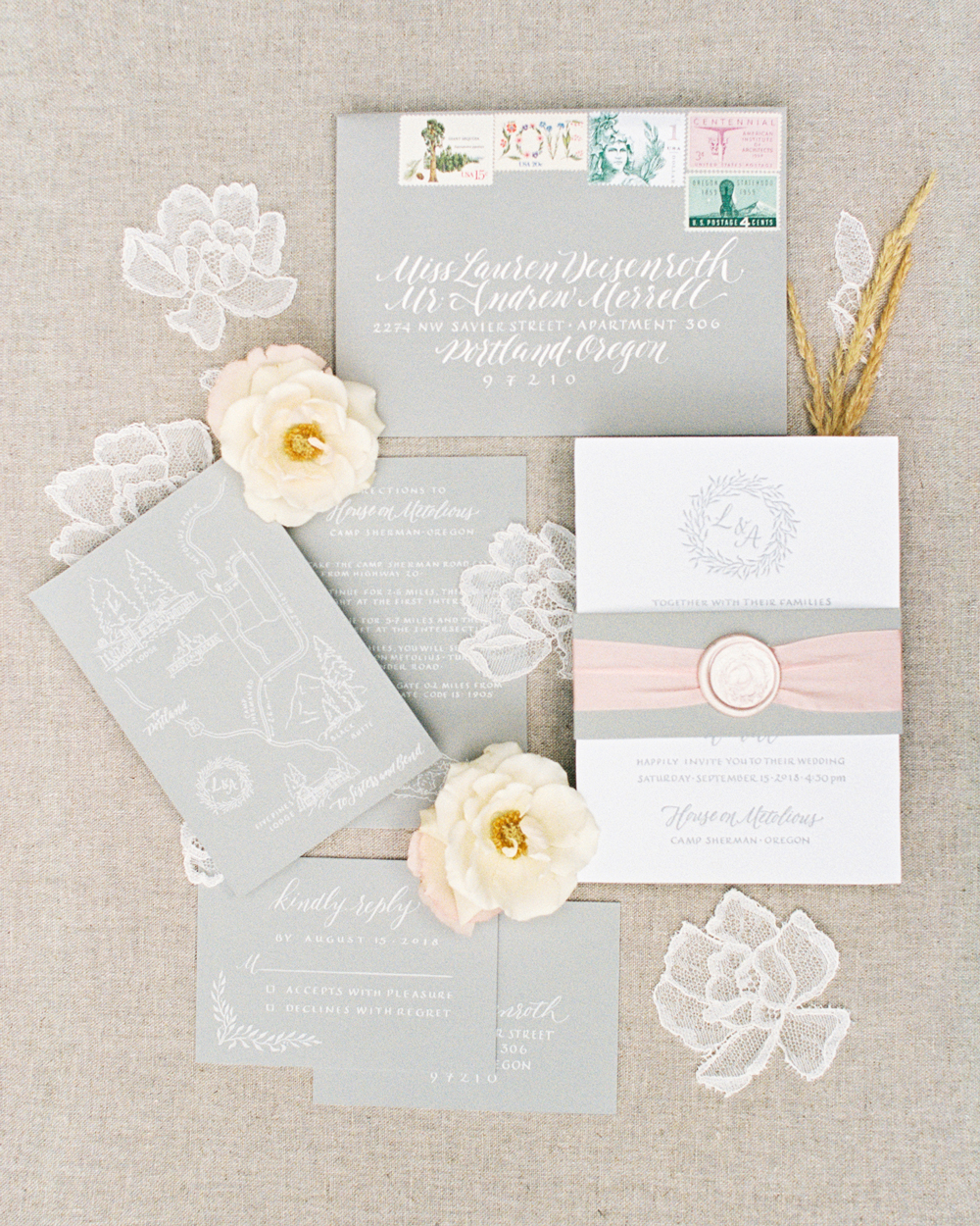 ribbon wedding ideas wax seal and pink ribbon wrapped around invitation