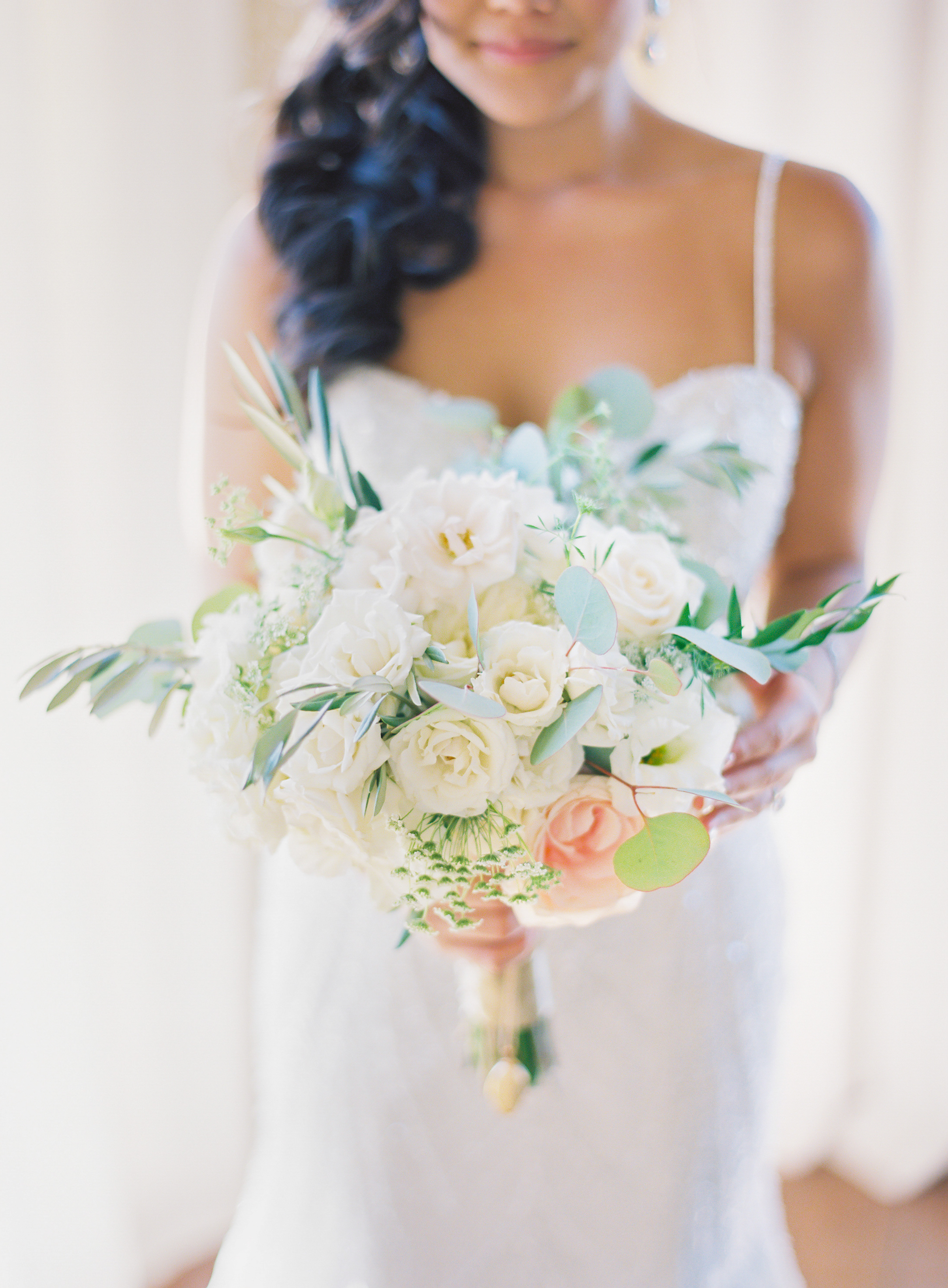 bride holding white bouquet