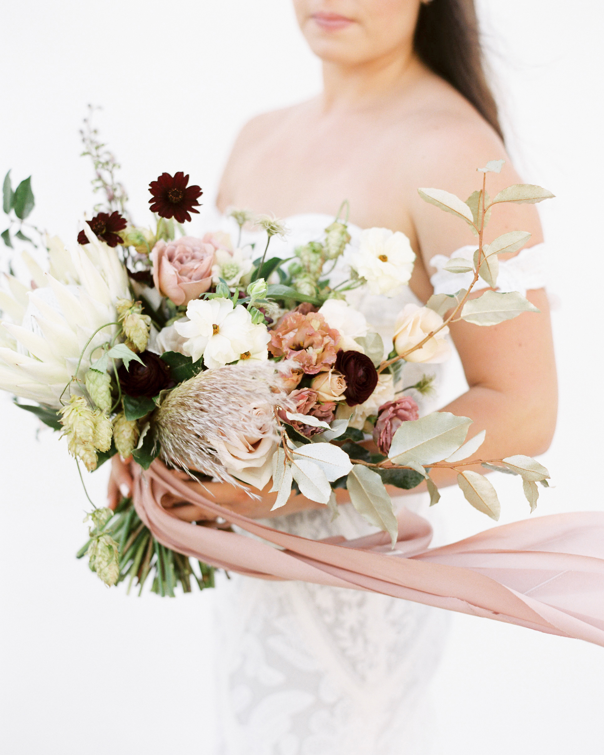 ribbon wedding ideas pink ribbon tied around bridal bouquet
