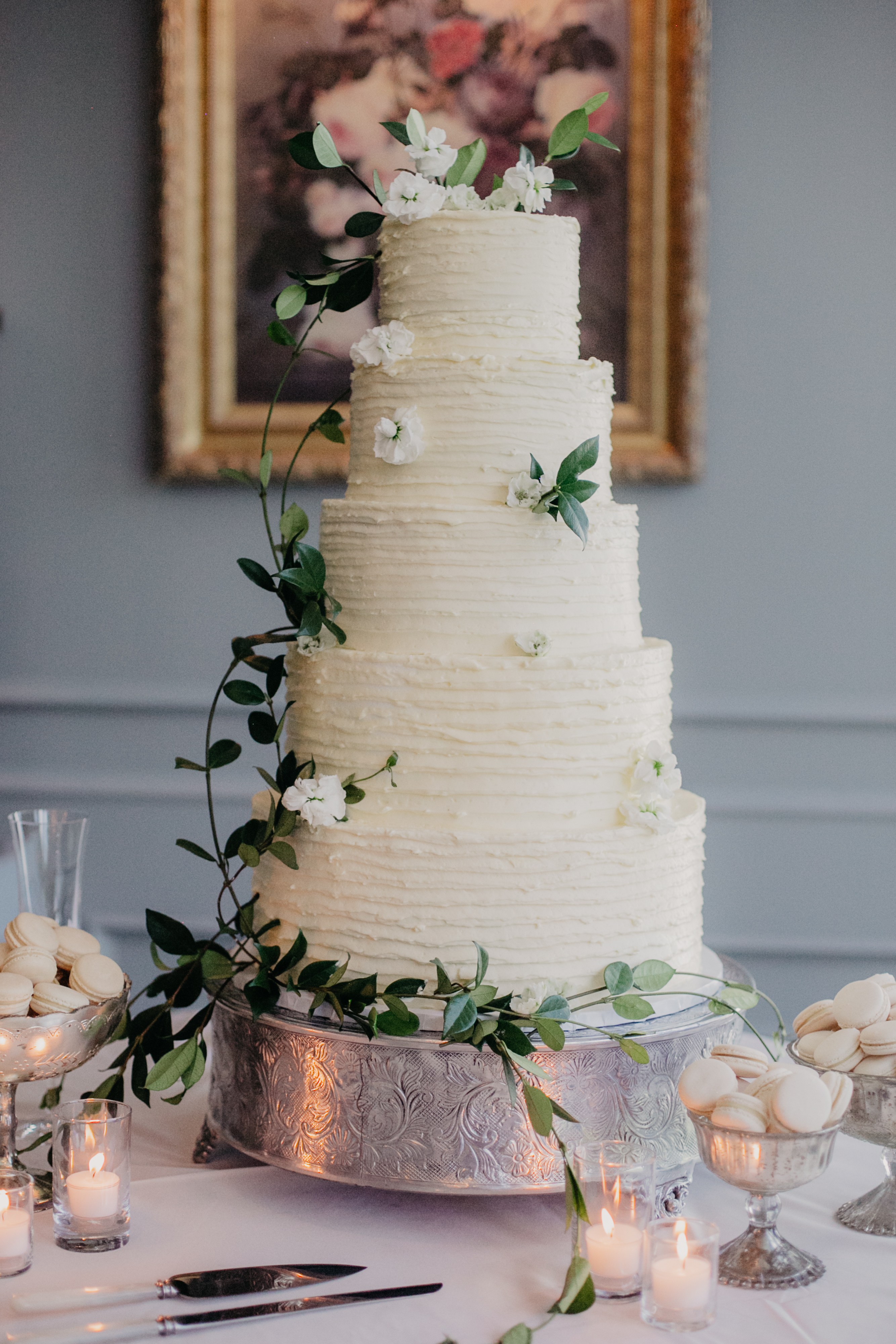 large white wedding cake with silver base