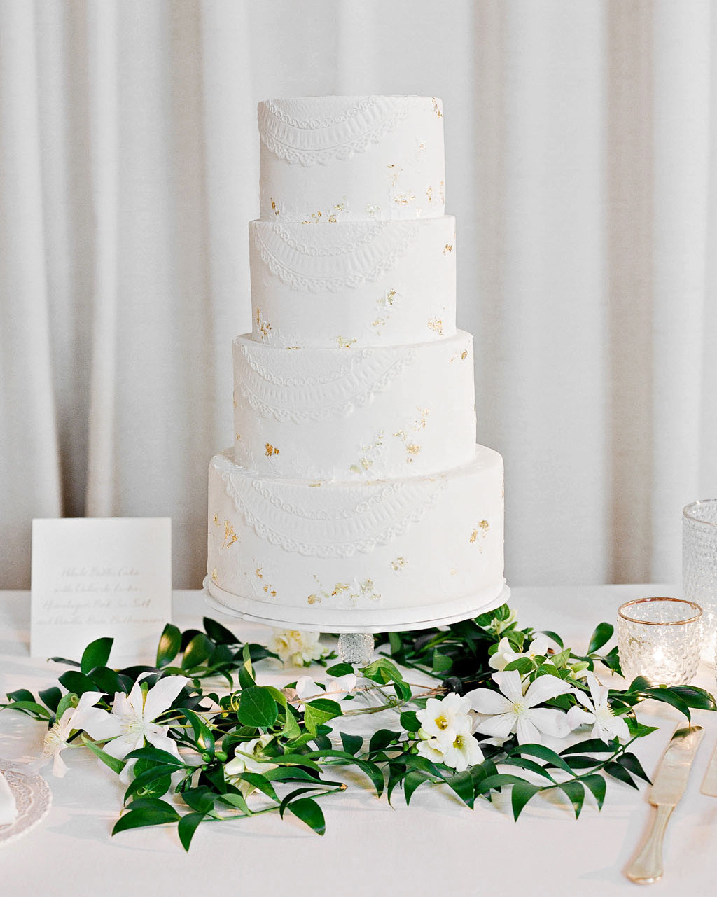 white wedding cake with gold flecks