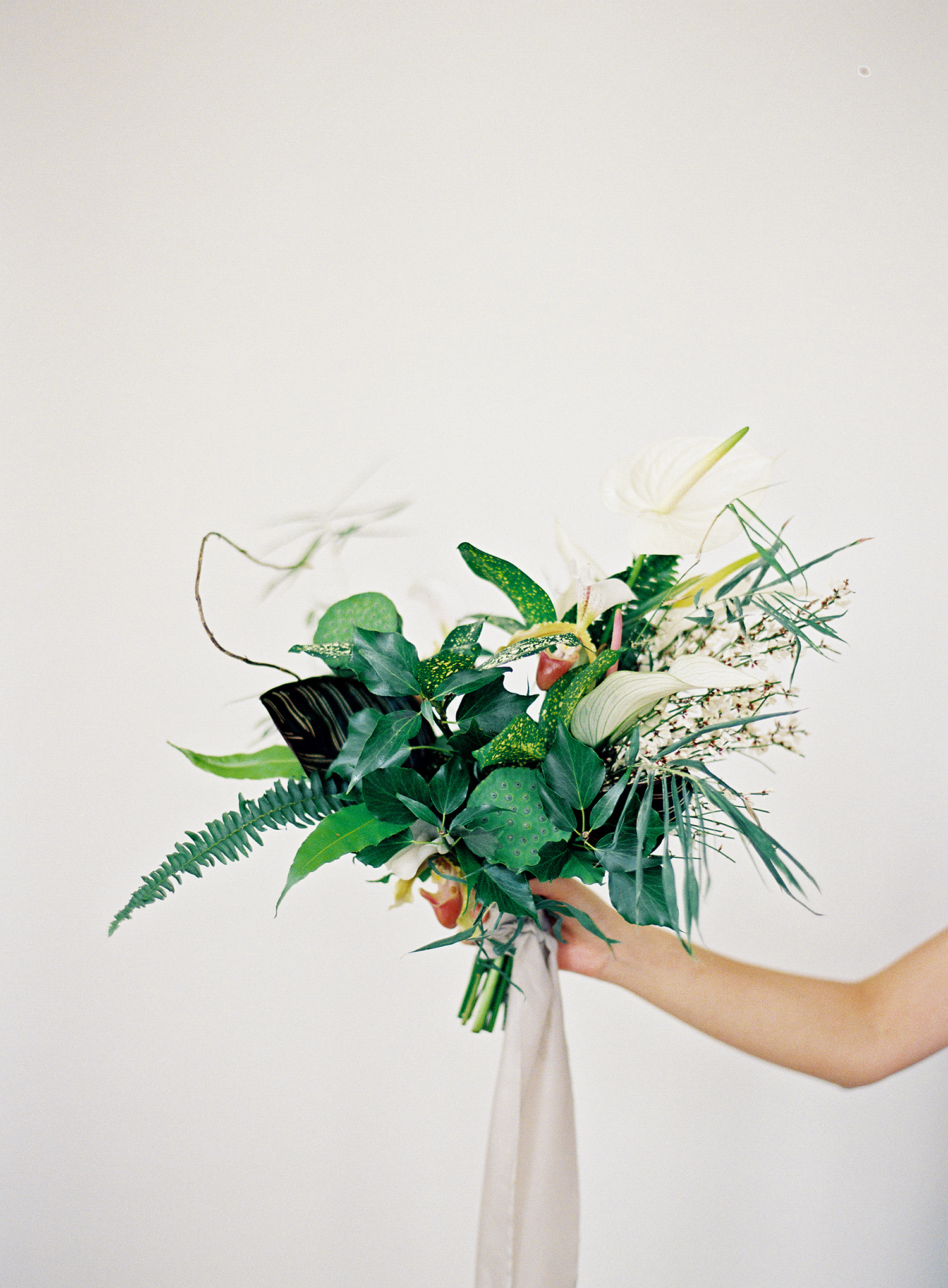 modern wedding bouquet tropical greenery