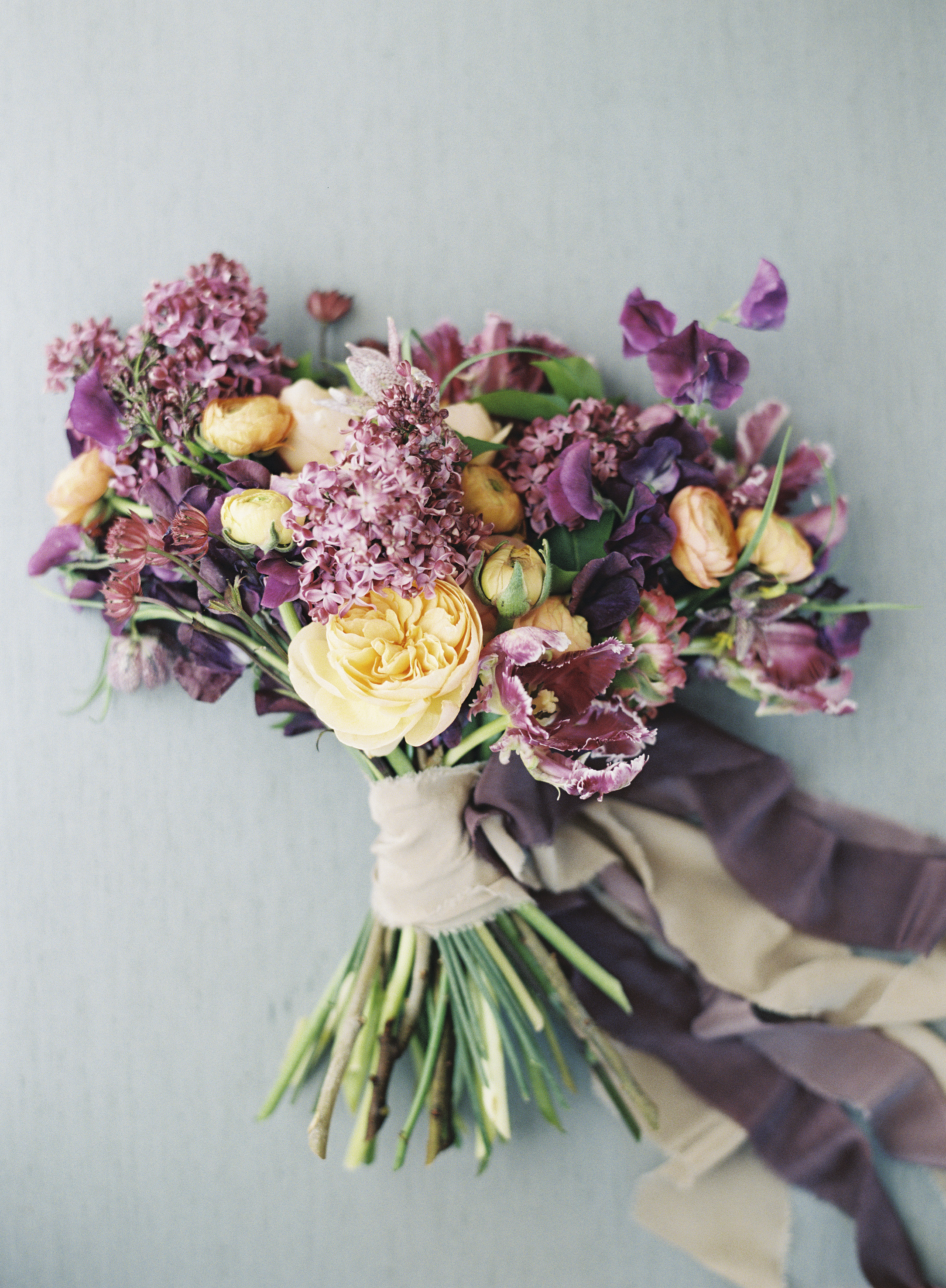 bouquet with lilacs yellow garden roses