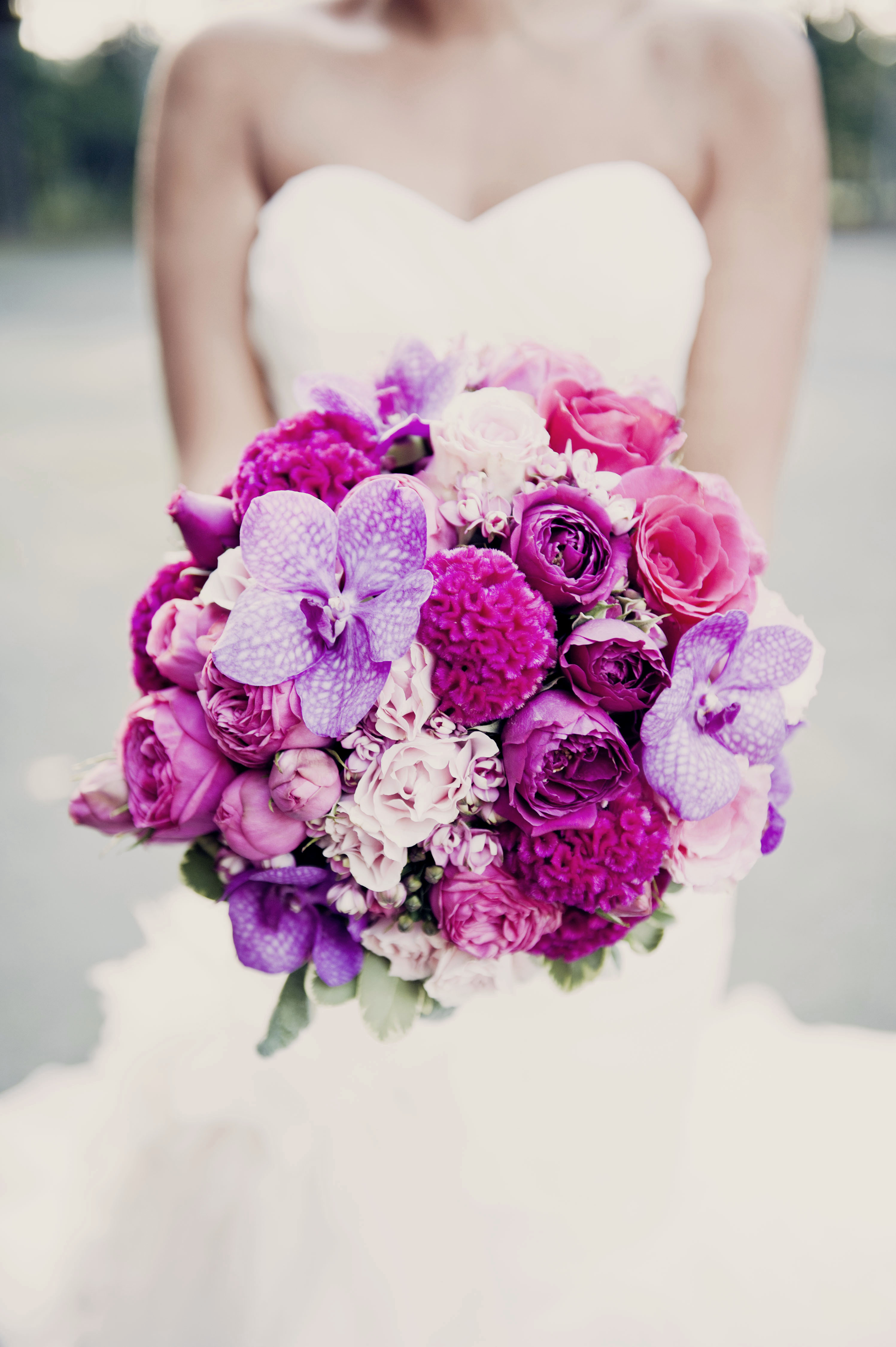 Bright pink and purple orchid wedding bouquet