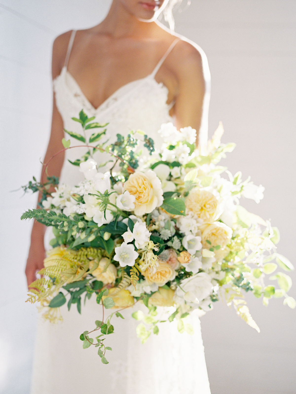 yellow and white florals mixed with greenery spring bouquet