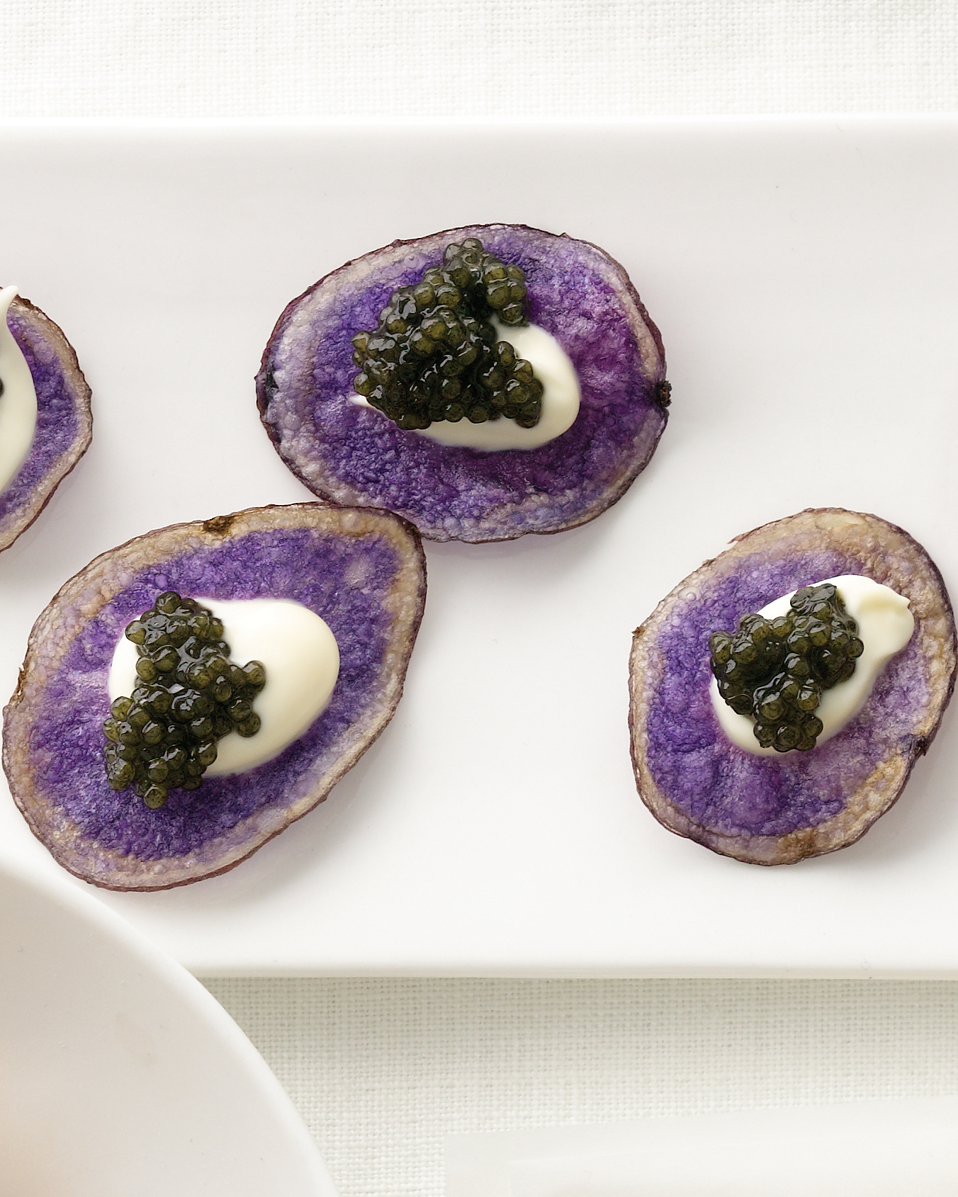 Purple Potato Chips With Crème Fraîche and Caviar
