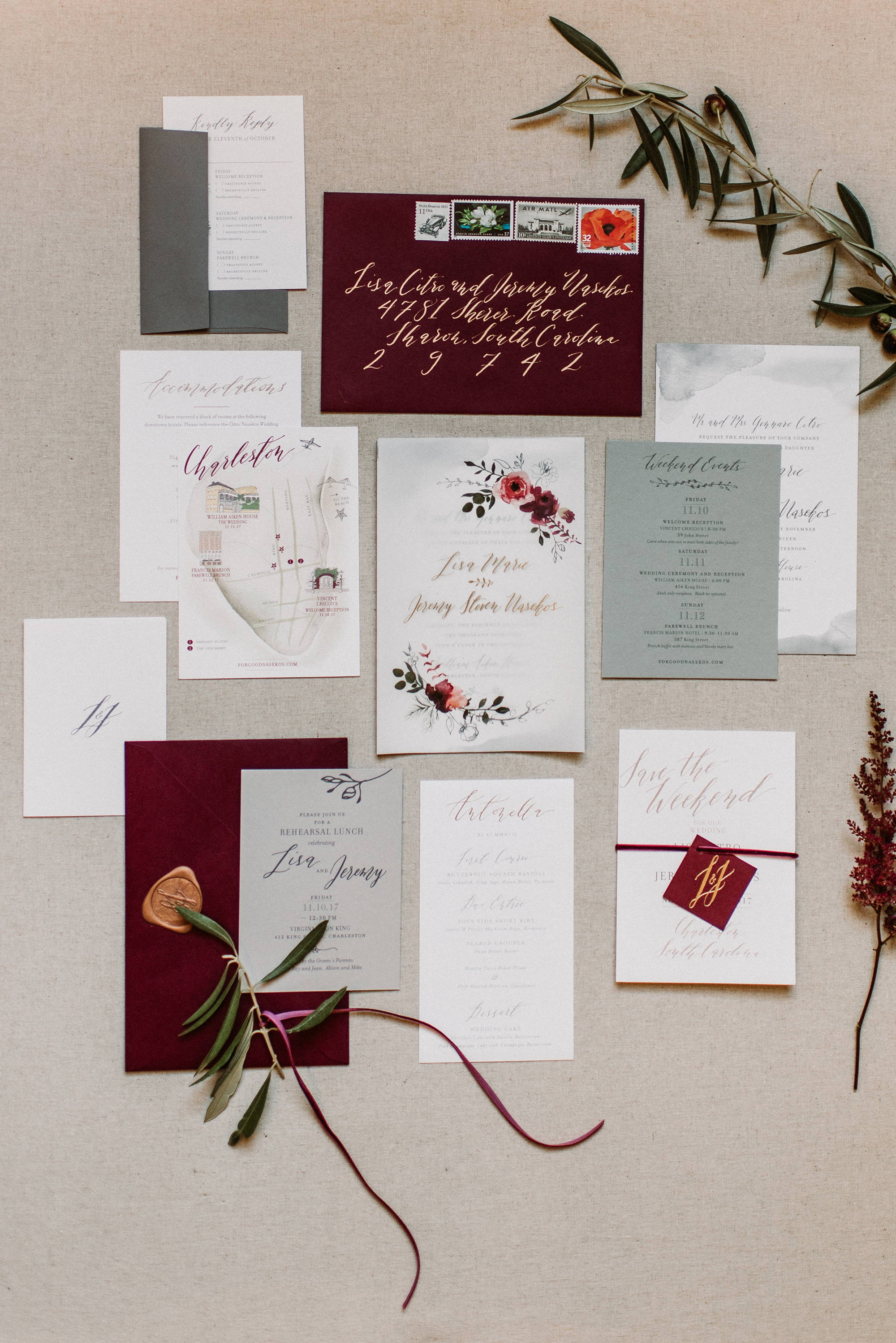 maroon and gray invitation suite with floral details
