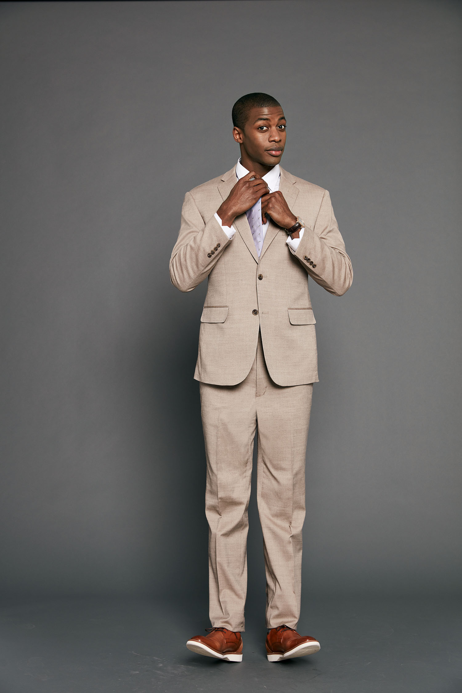 Tan suit for groom