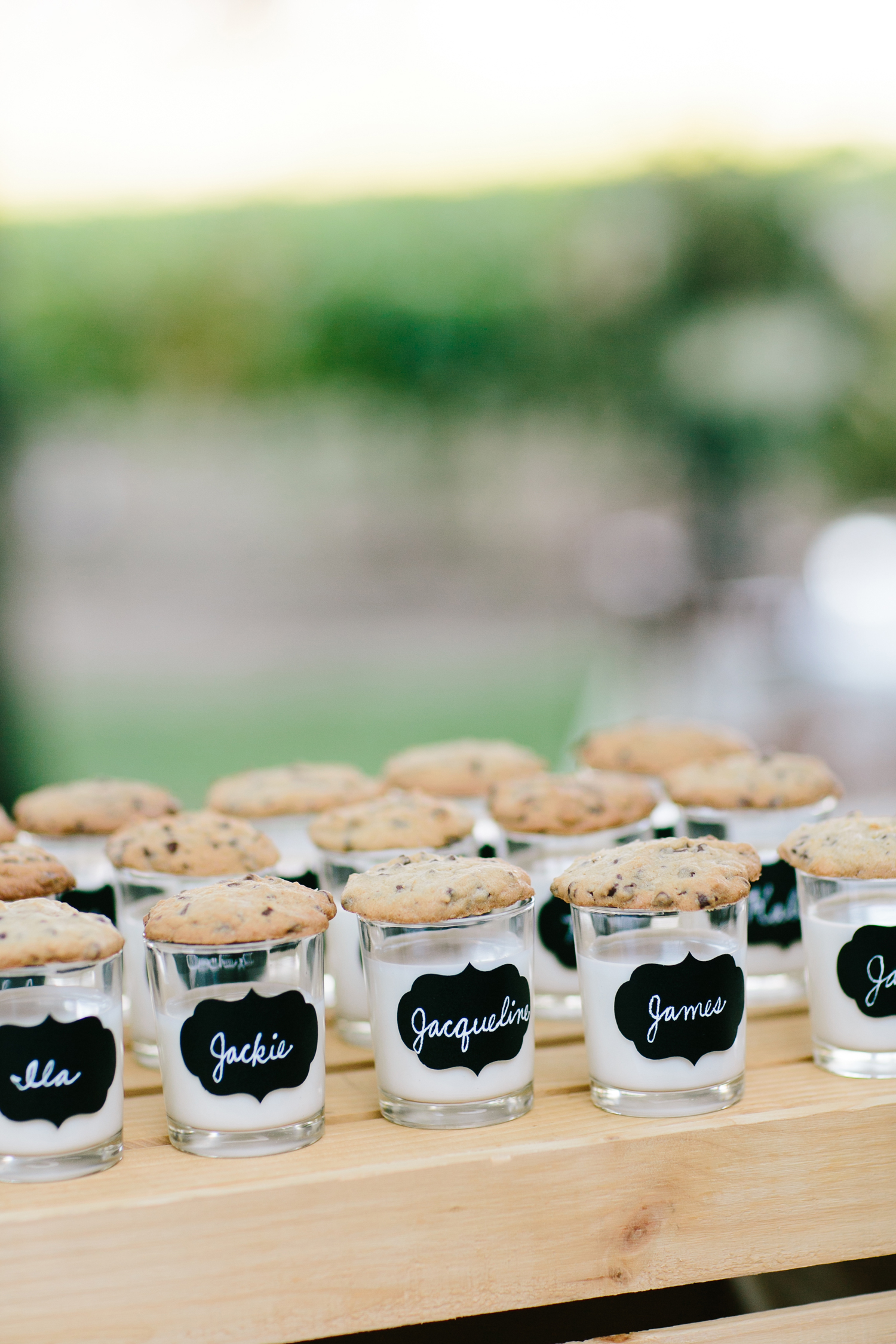 shot glass of milk escort card cookies