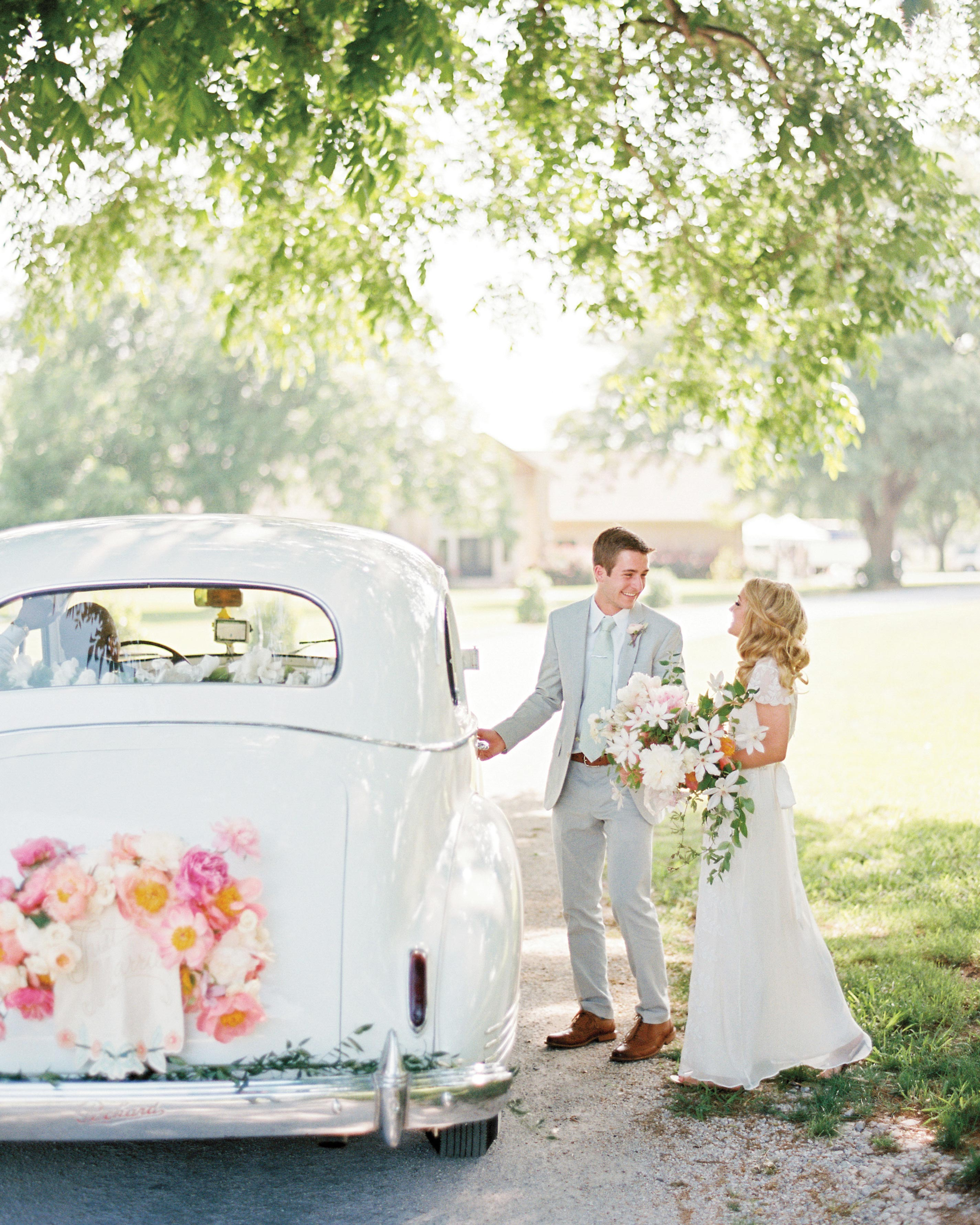 david-tyler-real-wedding-couple-leaving-getaway-car.jpg