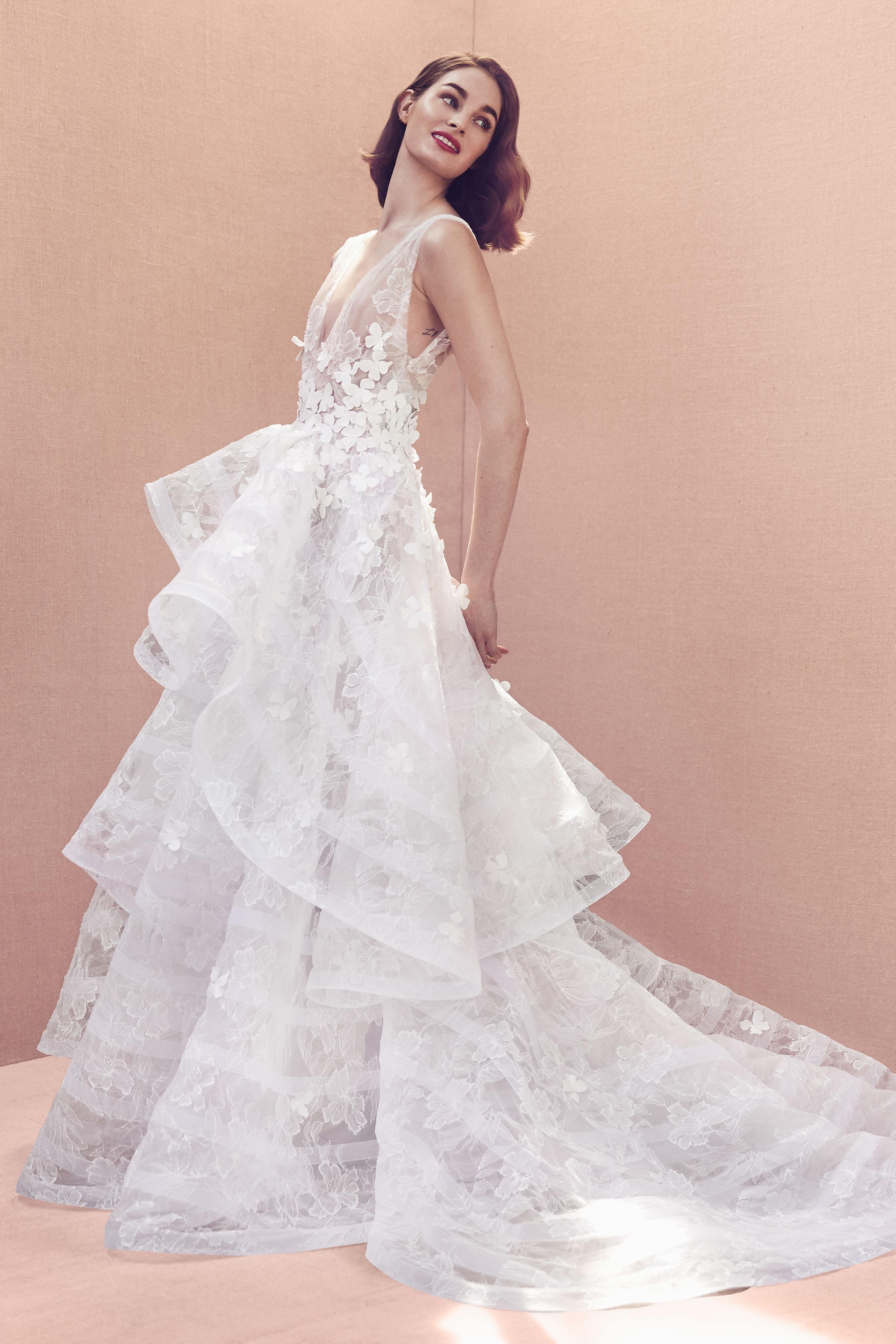 deep v-neck floral applique sleeveless tiered skirt a-line wedding dress Oscar de la Renta Spring 2020