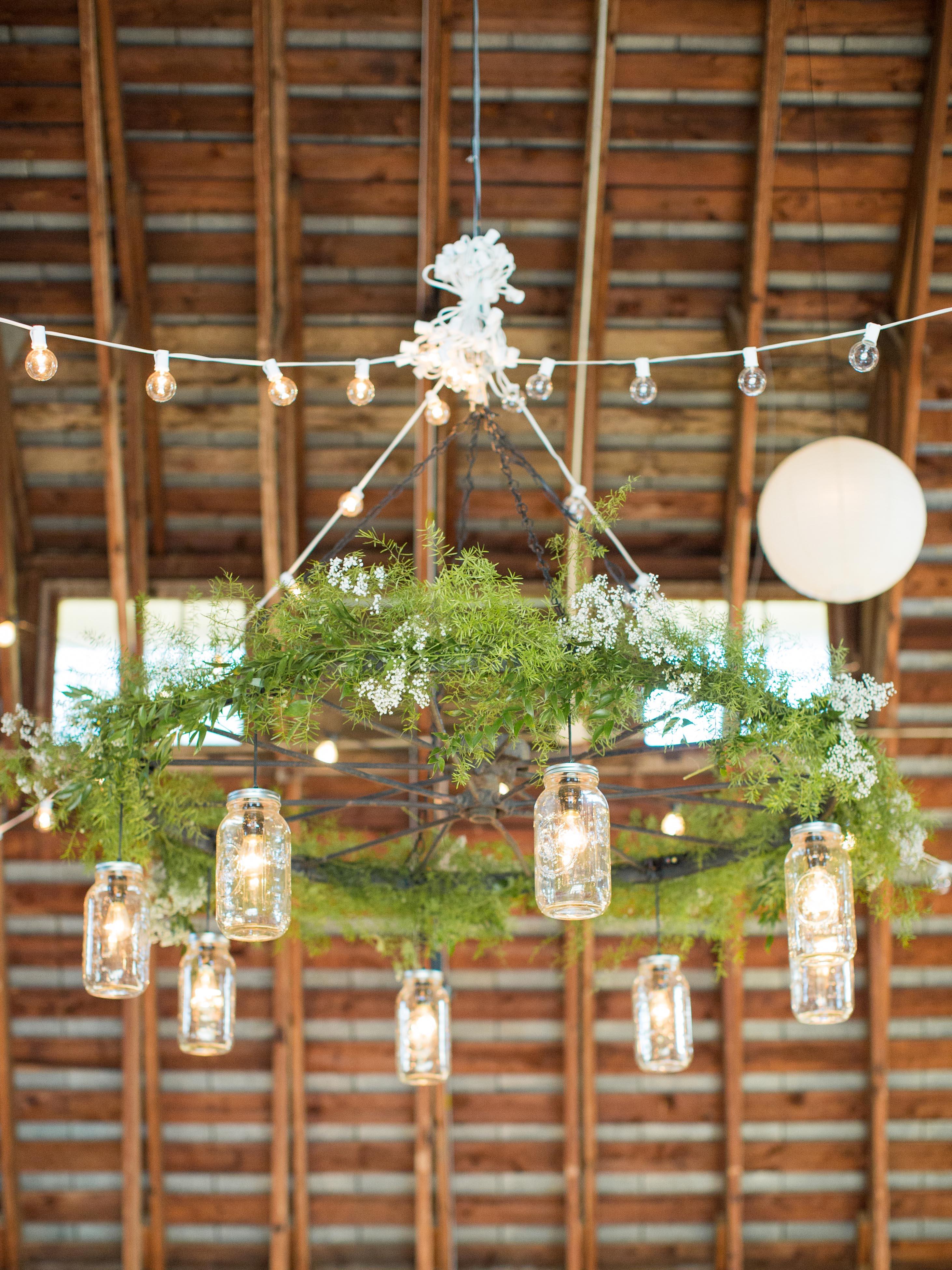 mason jar lighted chandelier with greenery