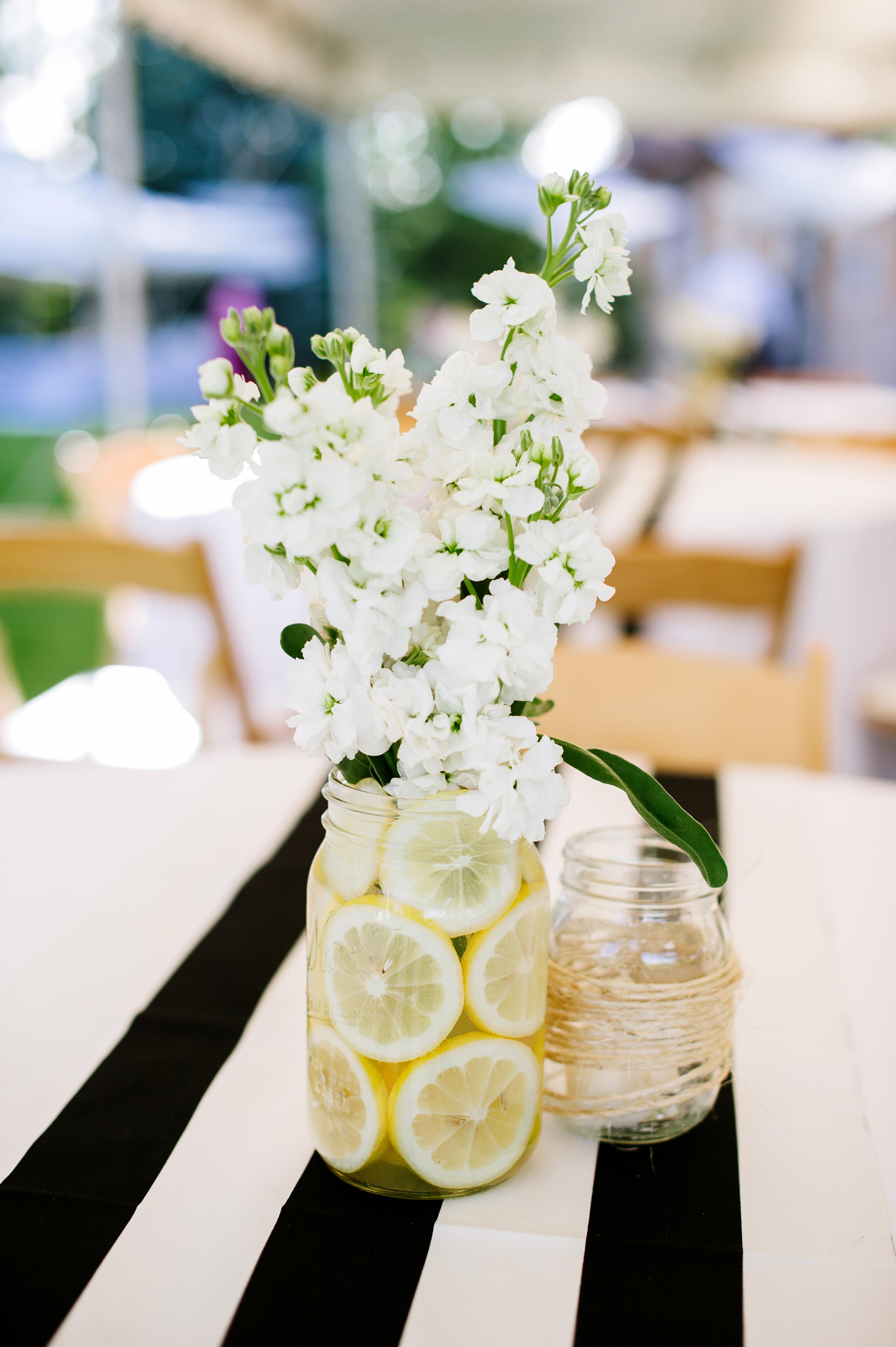 mason jar floral centerpiece with lemons