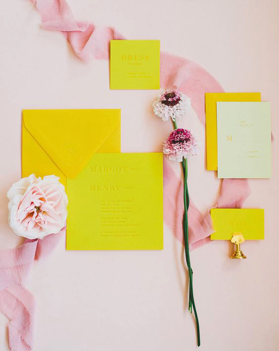neon yellow invitations with pink accents