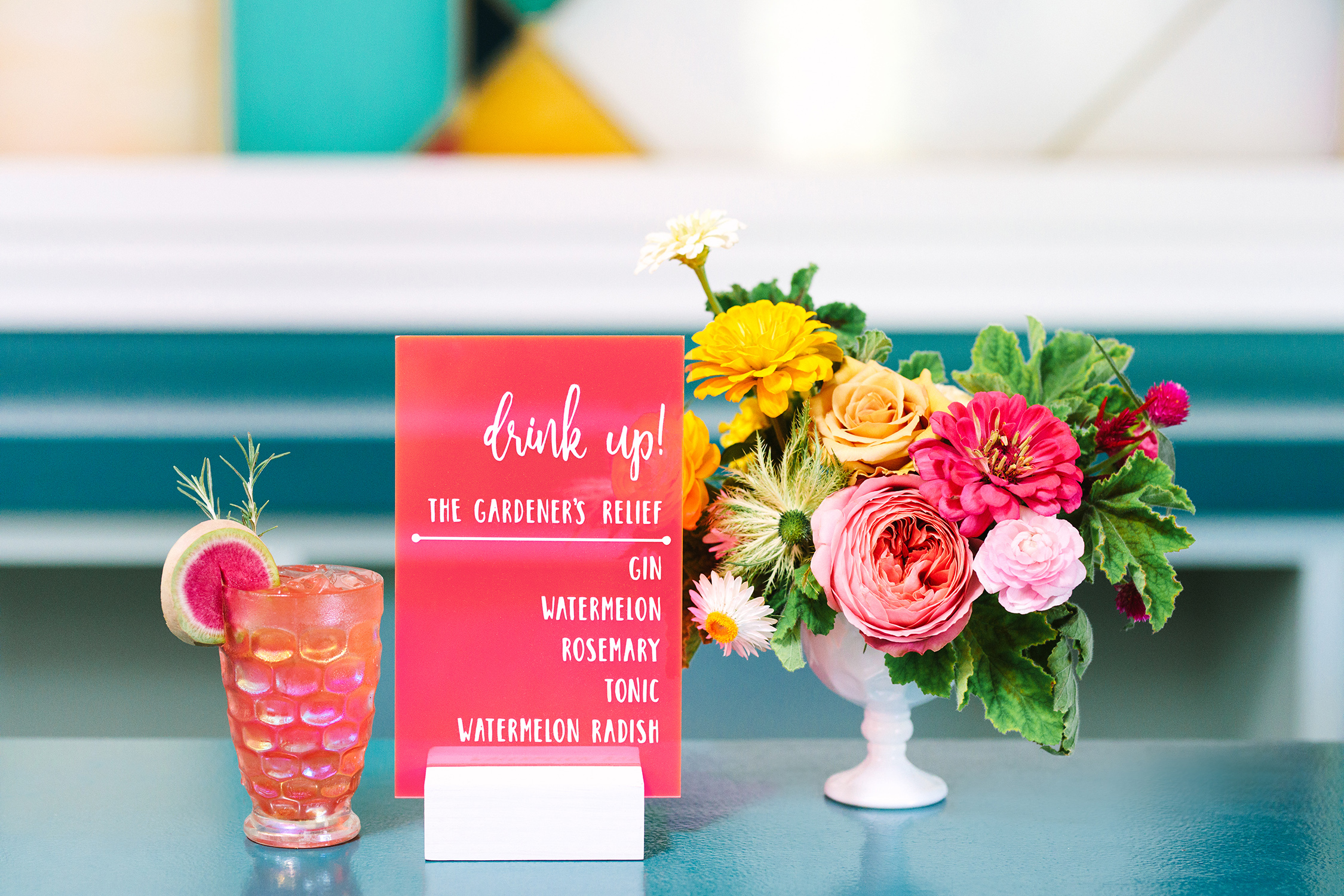 neon pink drink sign and cocktail