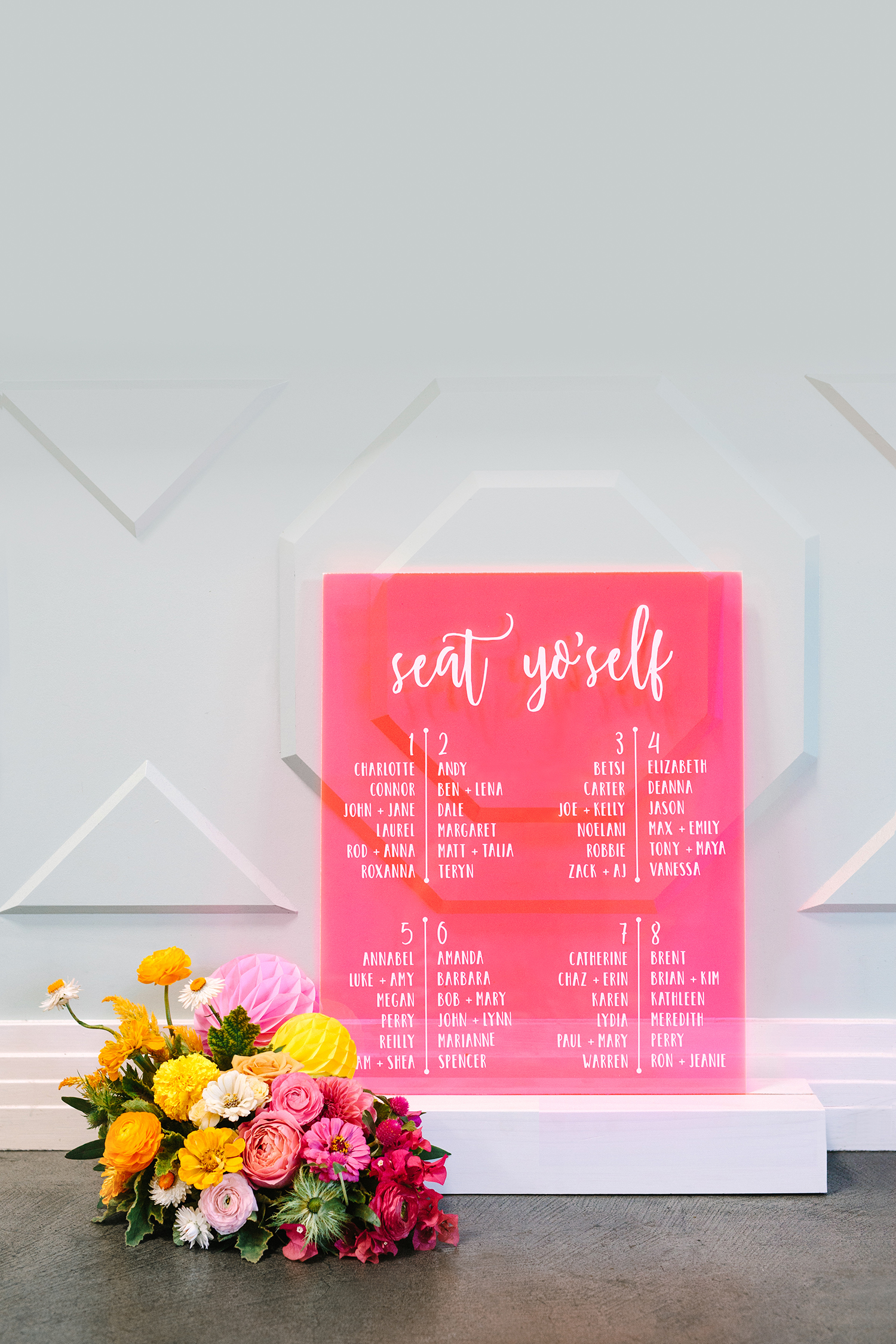 neon pink seat yourself sign