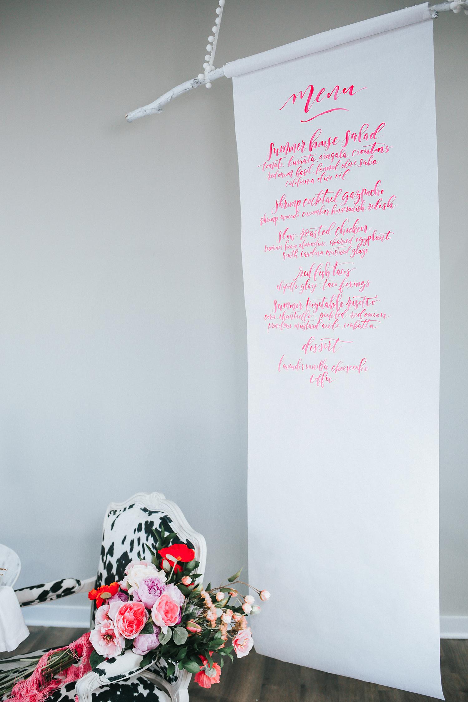 neon pink menu and matching floral arrangement