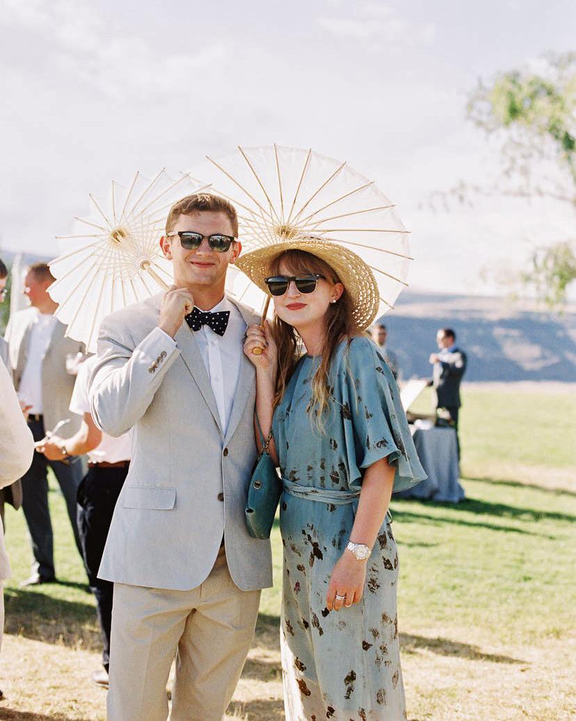 summer wedding guests umbrella