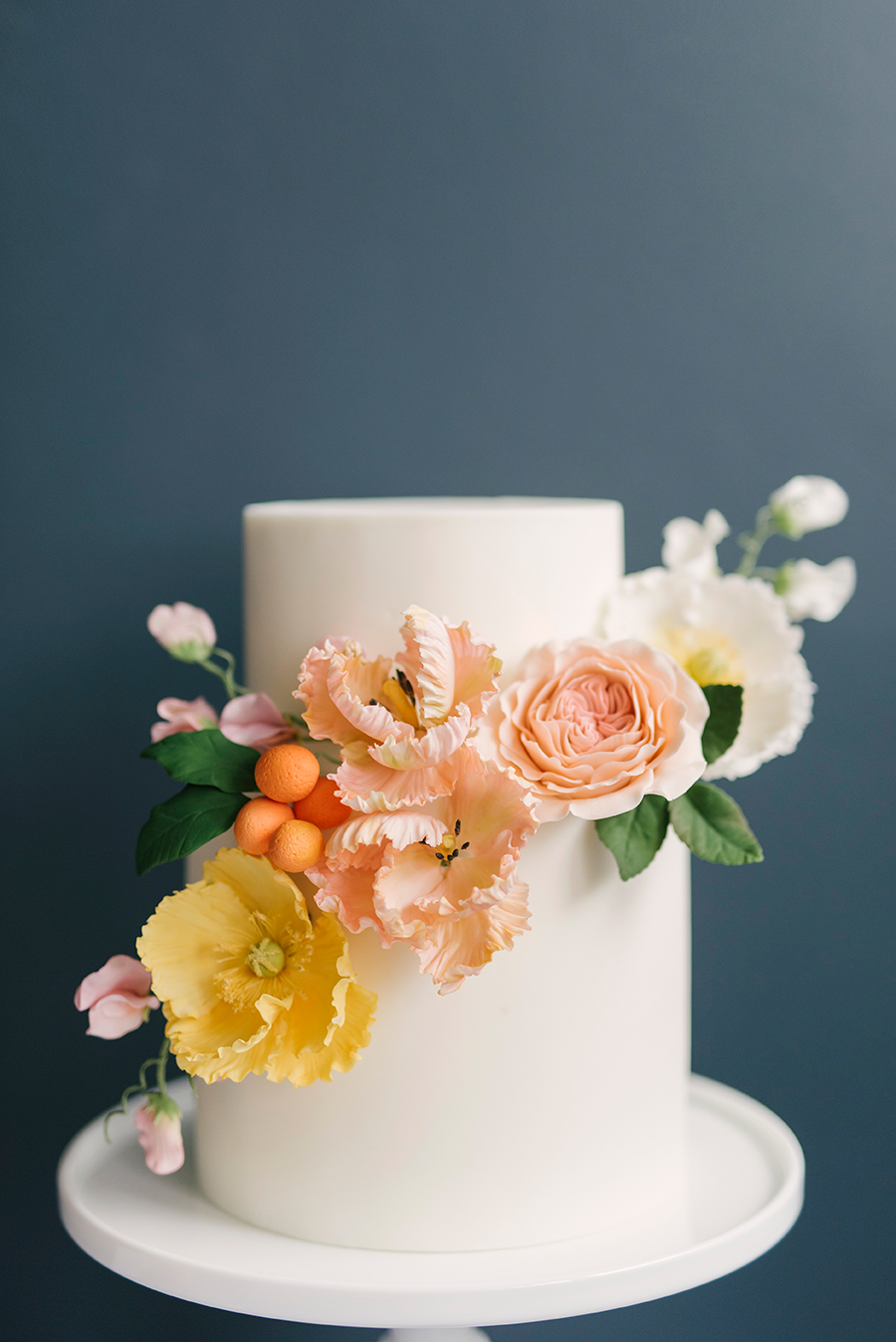 white fondant wedding cake with flowers