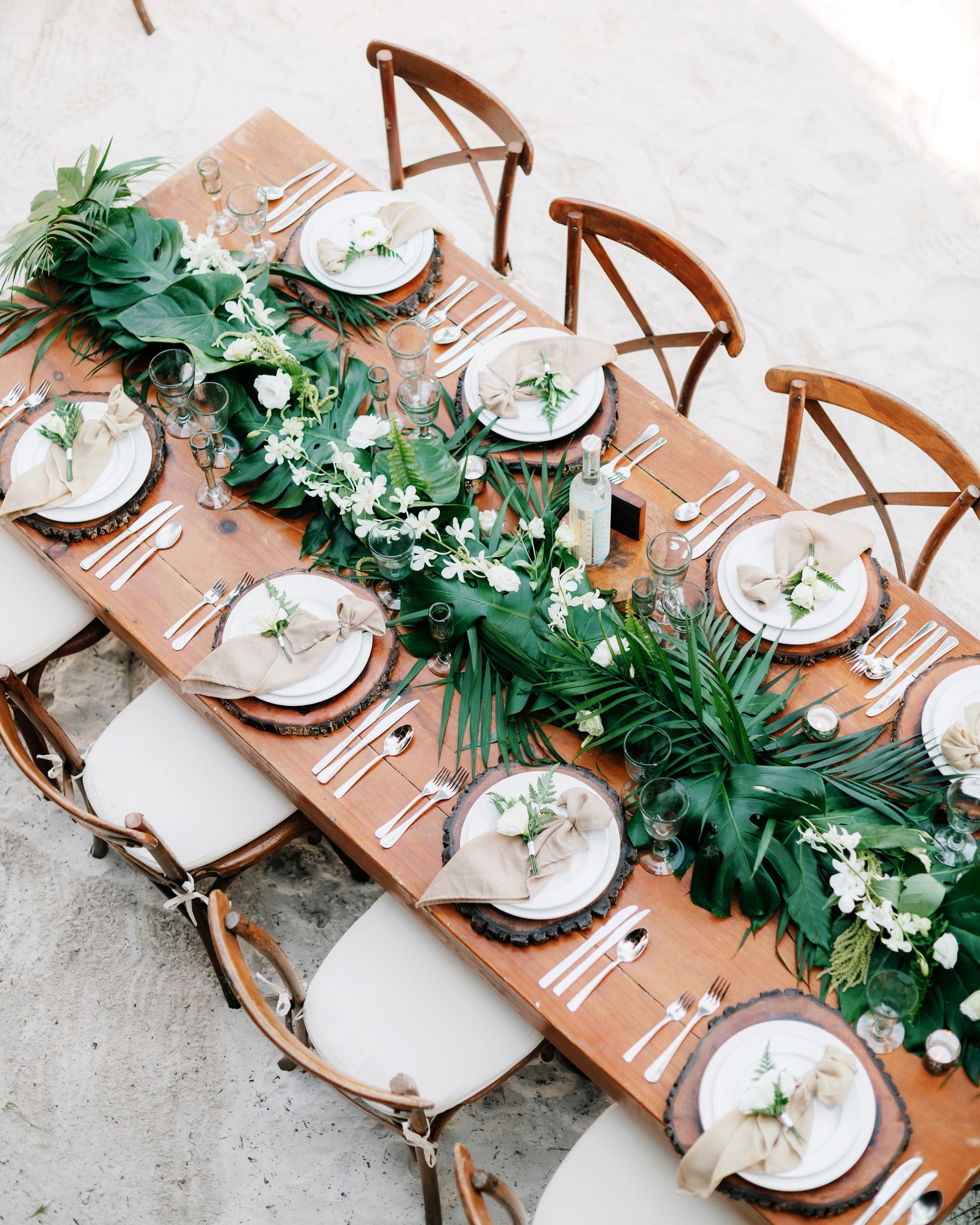 tropical wedding table setting palm leaves