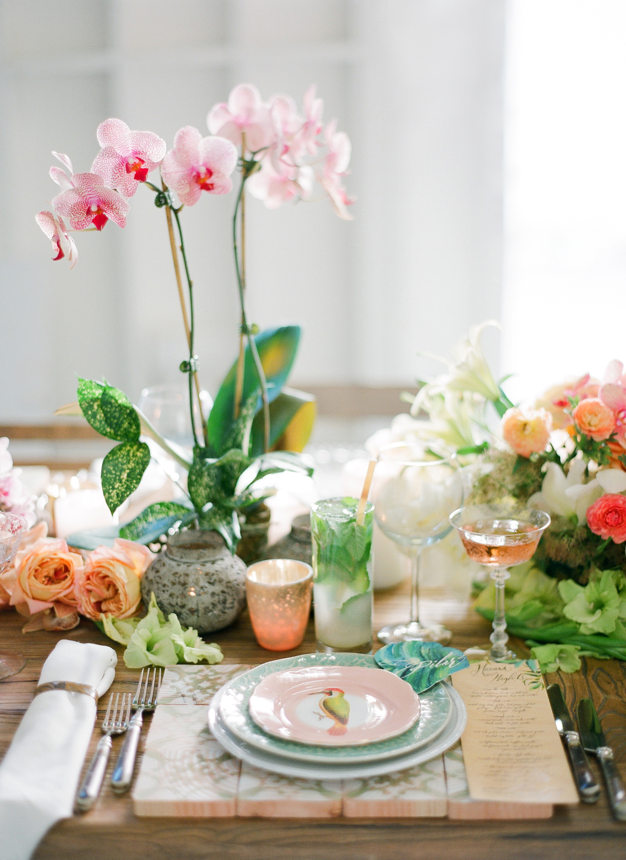 Tropical Place Setting with Orchids and Patterned Plates