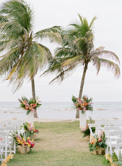 Tropical Ceremony Setting with Baskets of Native Flowers
