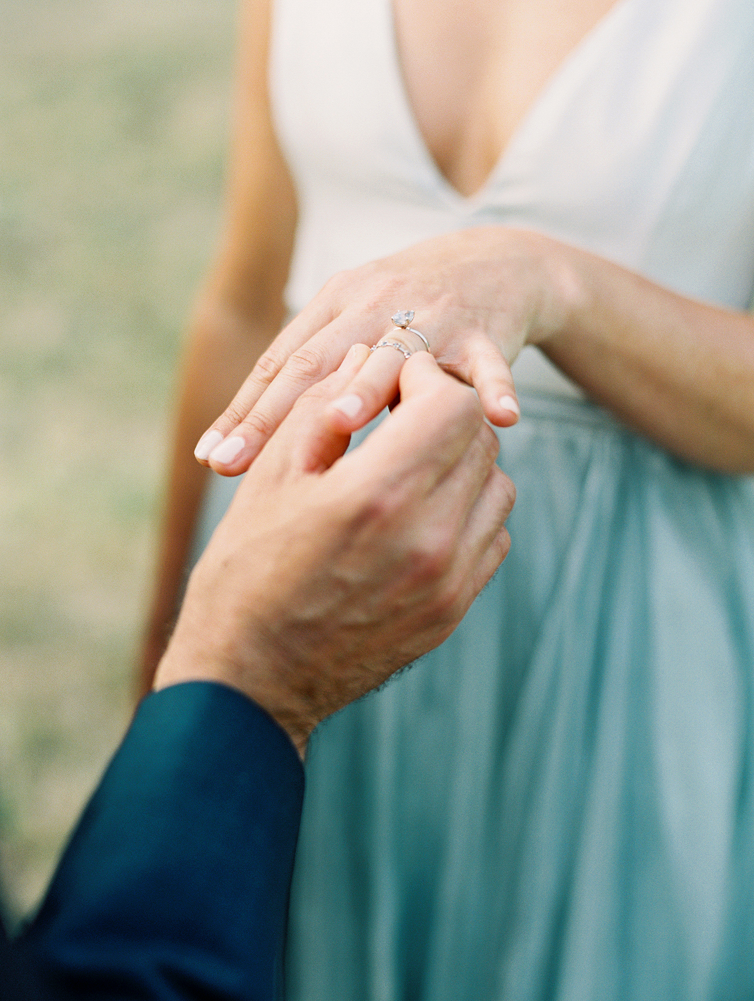 kelly pete wedding groom placing ring on brides finger