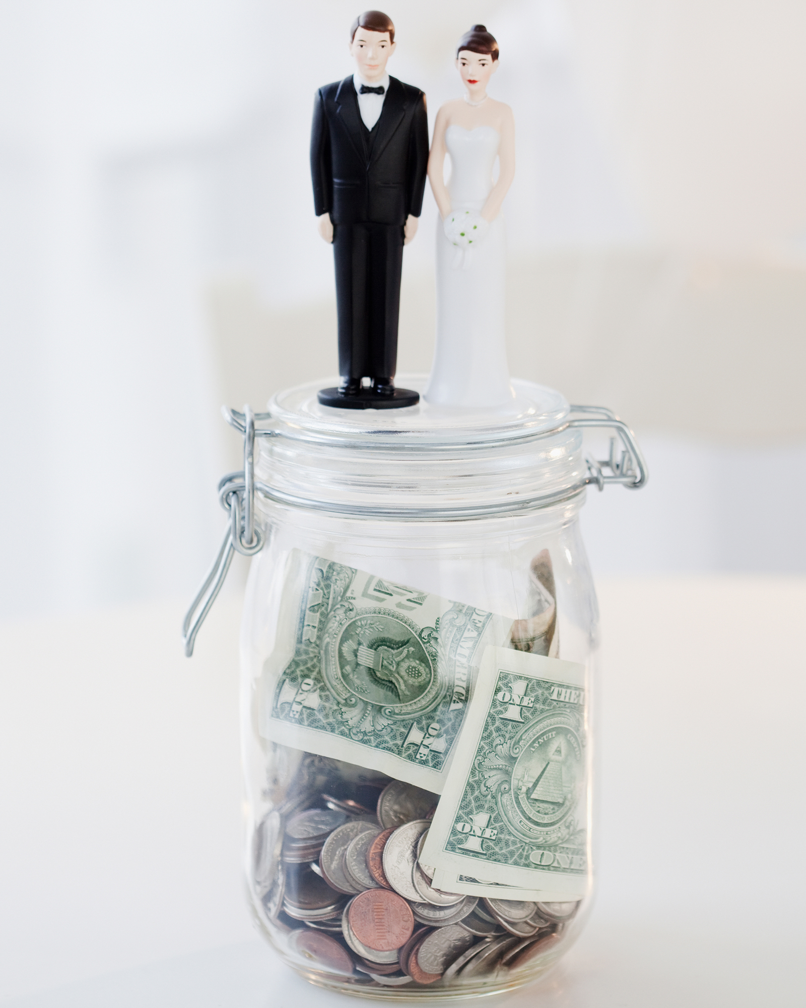 bride and groom figurines on money jar