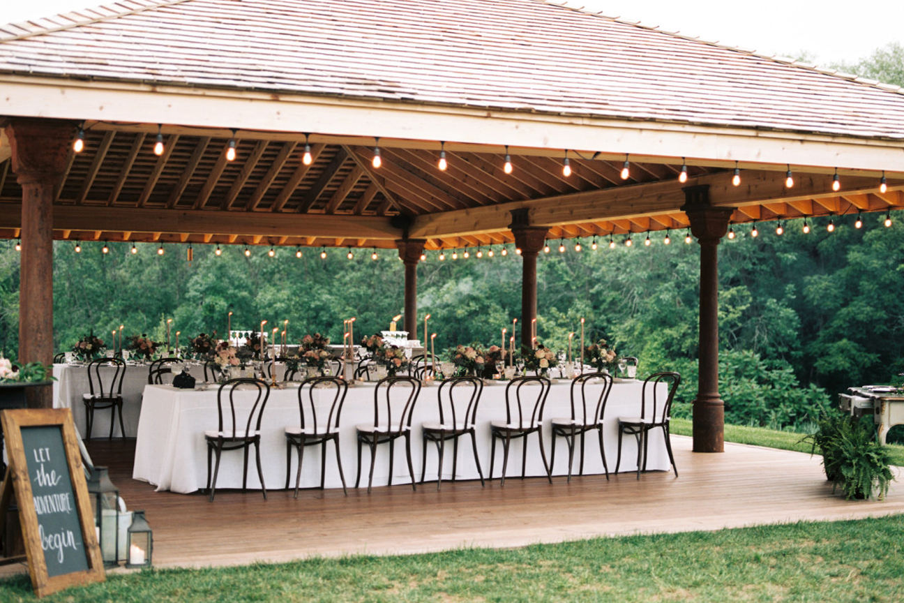 air bnb wedding venue tables set in outdoor gazebo