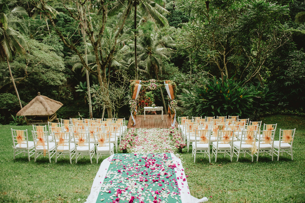 air bnb wedding venue ceremony in bali forest with path of pink petals
