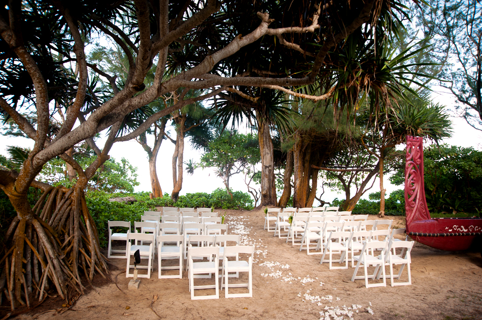 air bnb wedding venue white chairs on beach