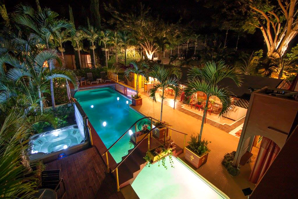 air bnb wedding venue evening lit pool surrounded by palm trees
