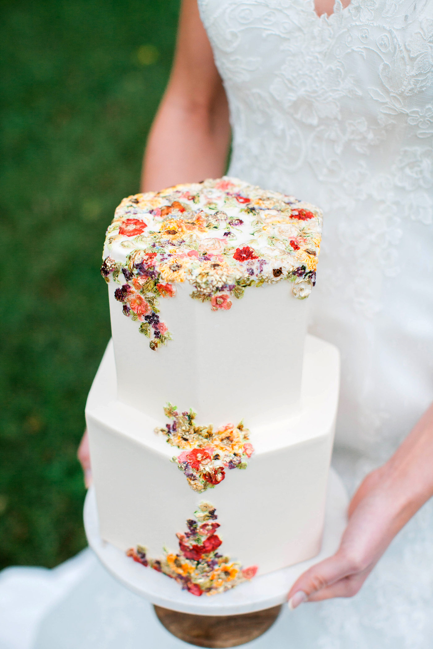 floral frosting design two tiered white wedding cake
