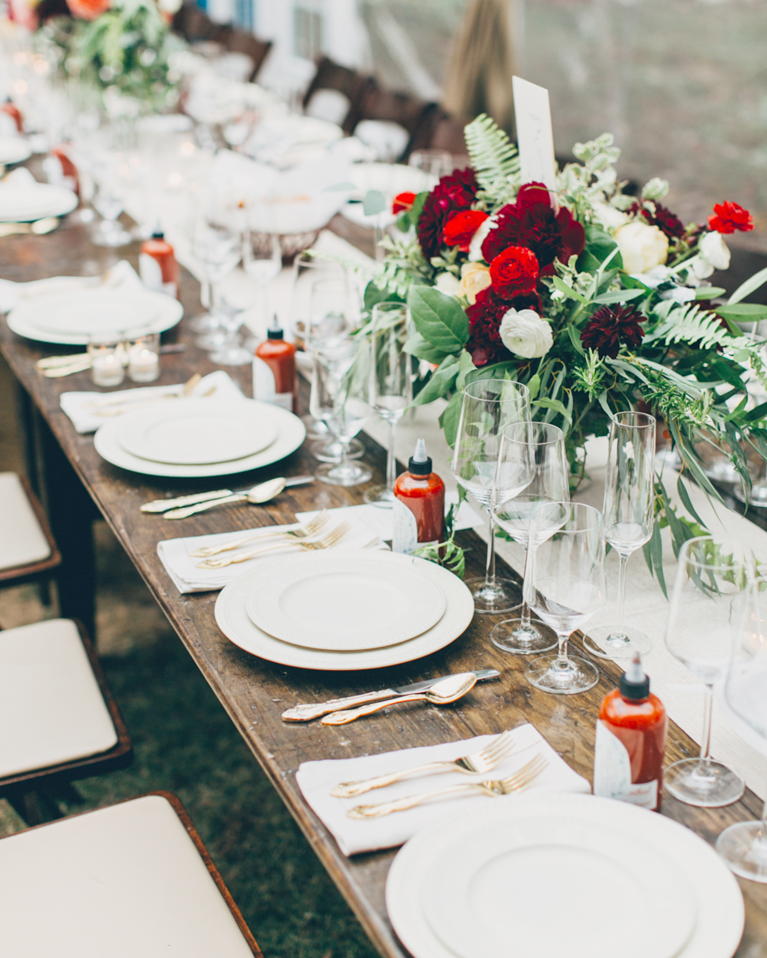 Long Reception Table with Red Flower Arrangements