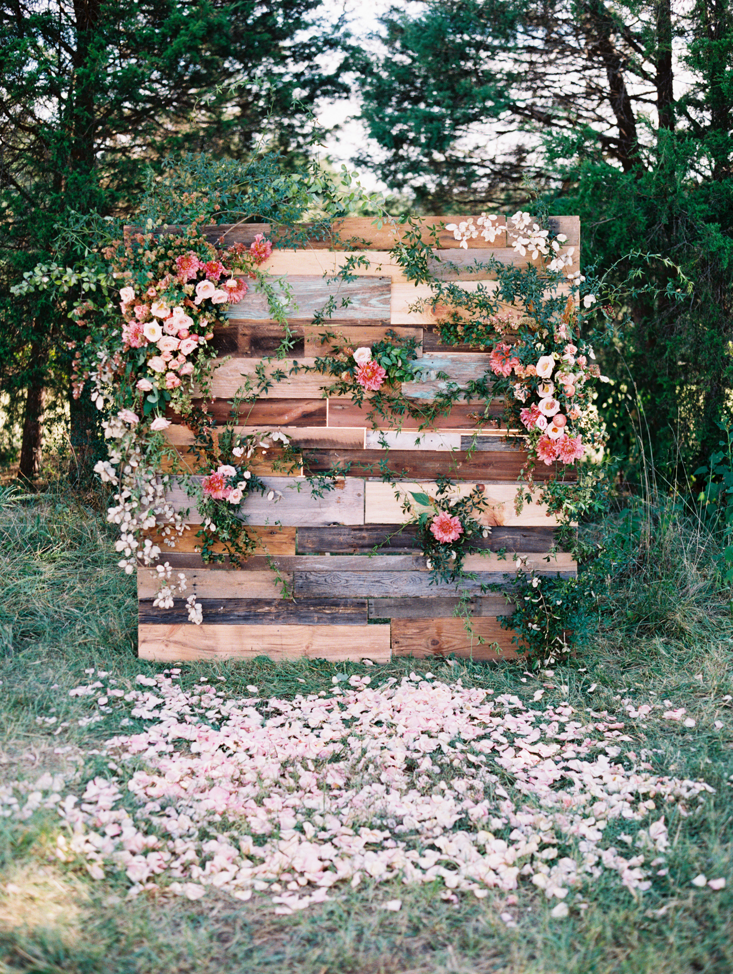 wedding backdrop free standing wood pallet pink blooms greenery