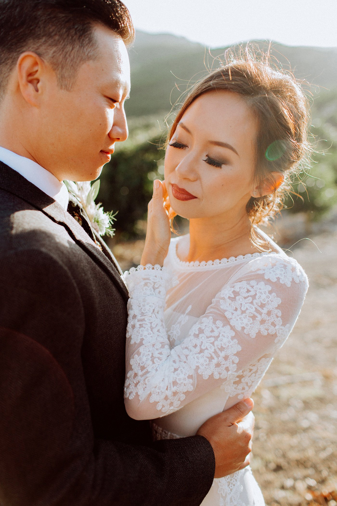 bold lipstick bride and groom embrace close up