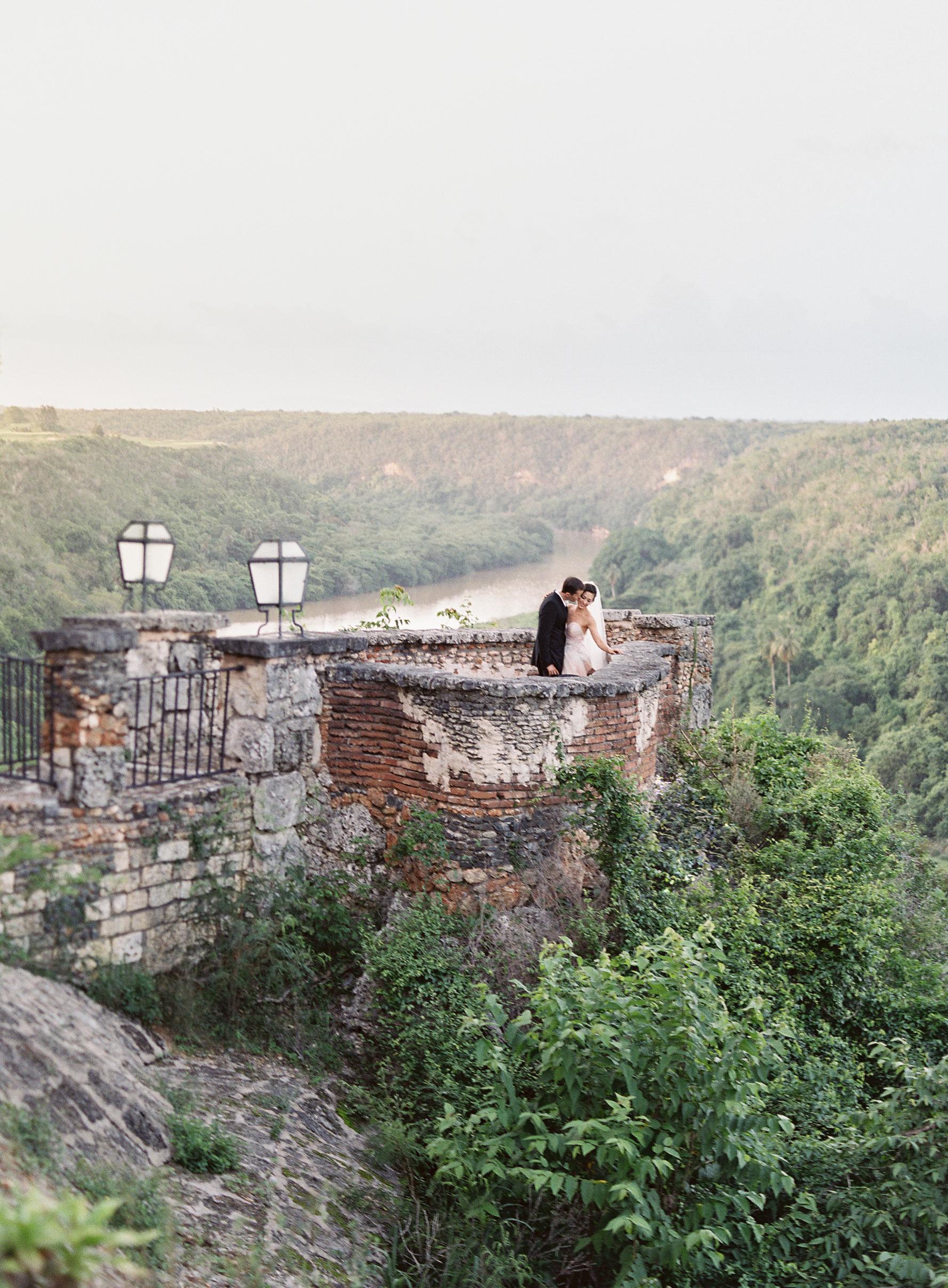 couple standing on balcony