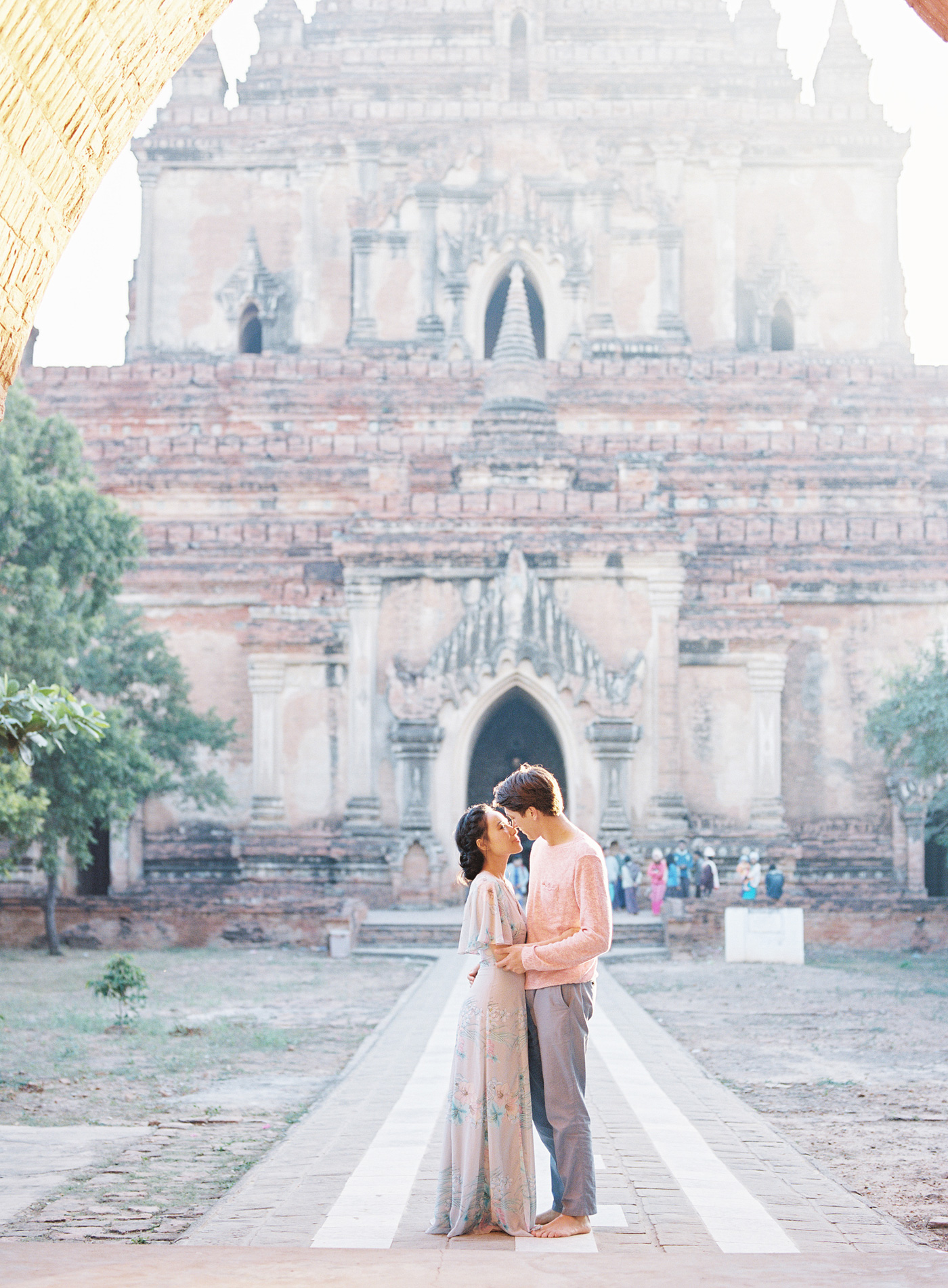 couple standing in front of temple