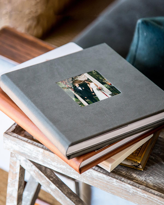 wedding photo albums lay-flat binding gray burnt orange on table