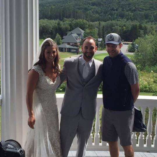 Justin Timberlake crashing a wedding and posing for a picture with the bride and groom