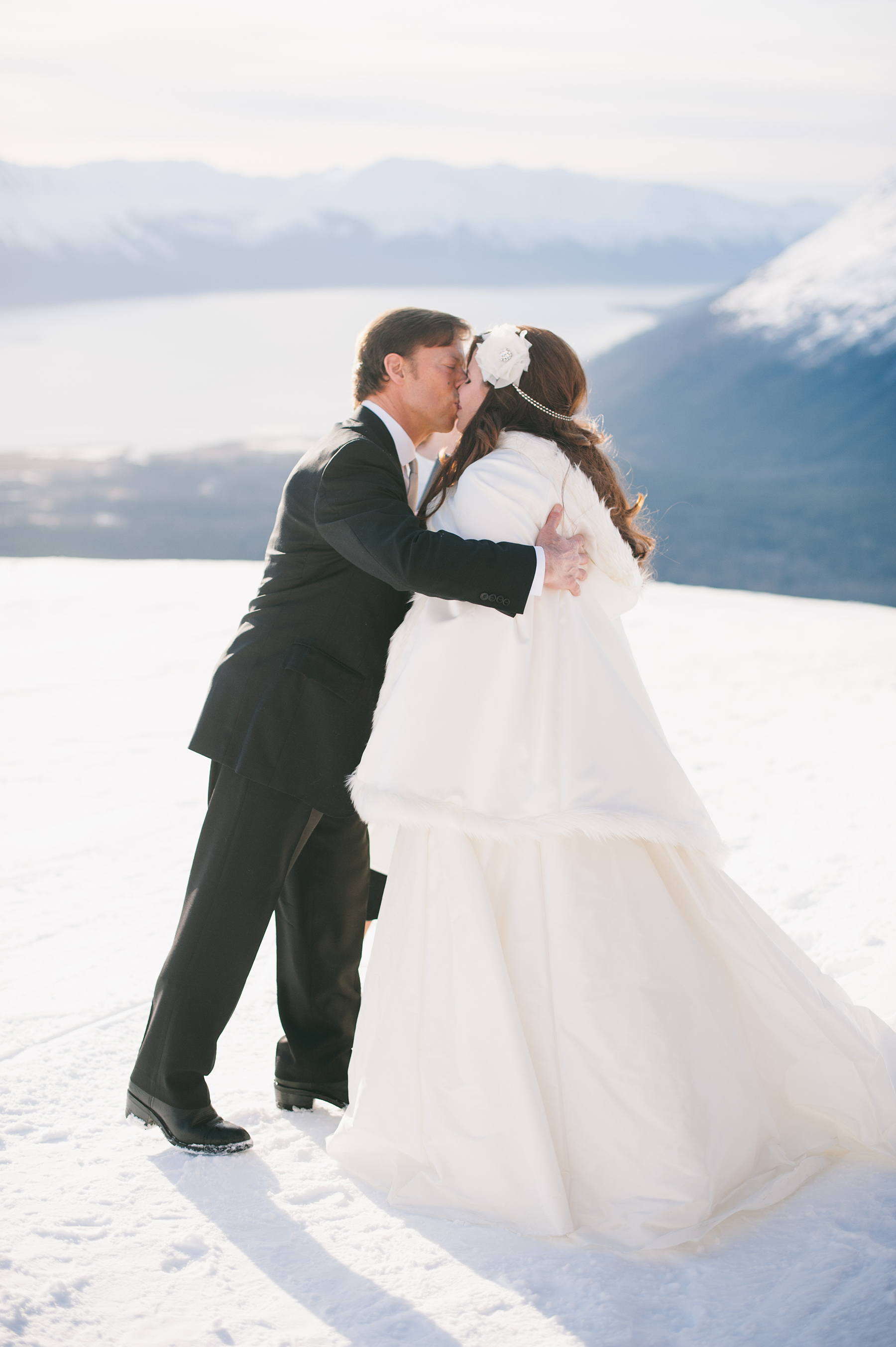 Bride and Groom Kissing on Mountain