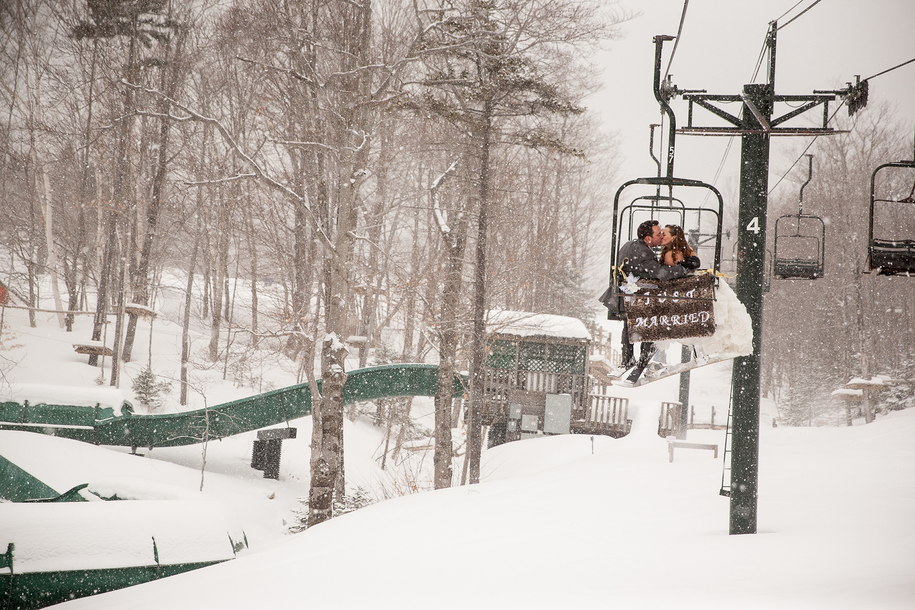 Couple Kissing on Ski Lift